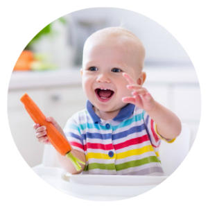 baby with carrot circle 300x300.png