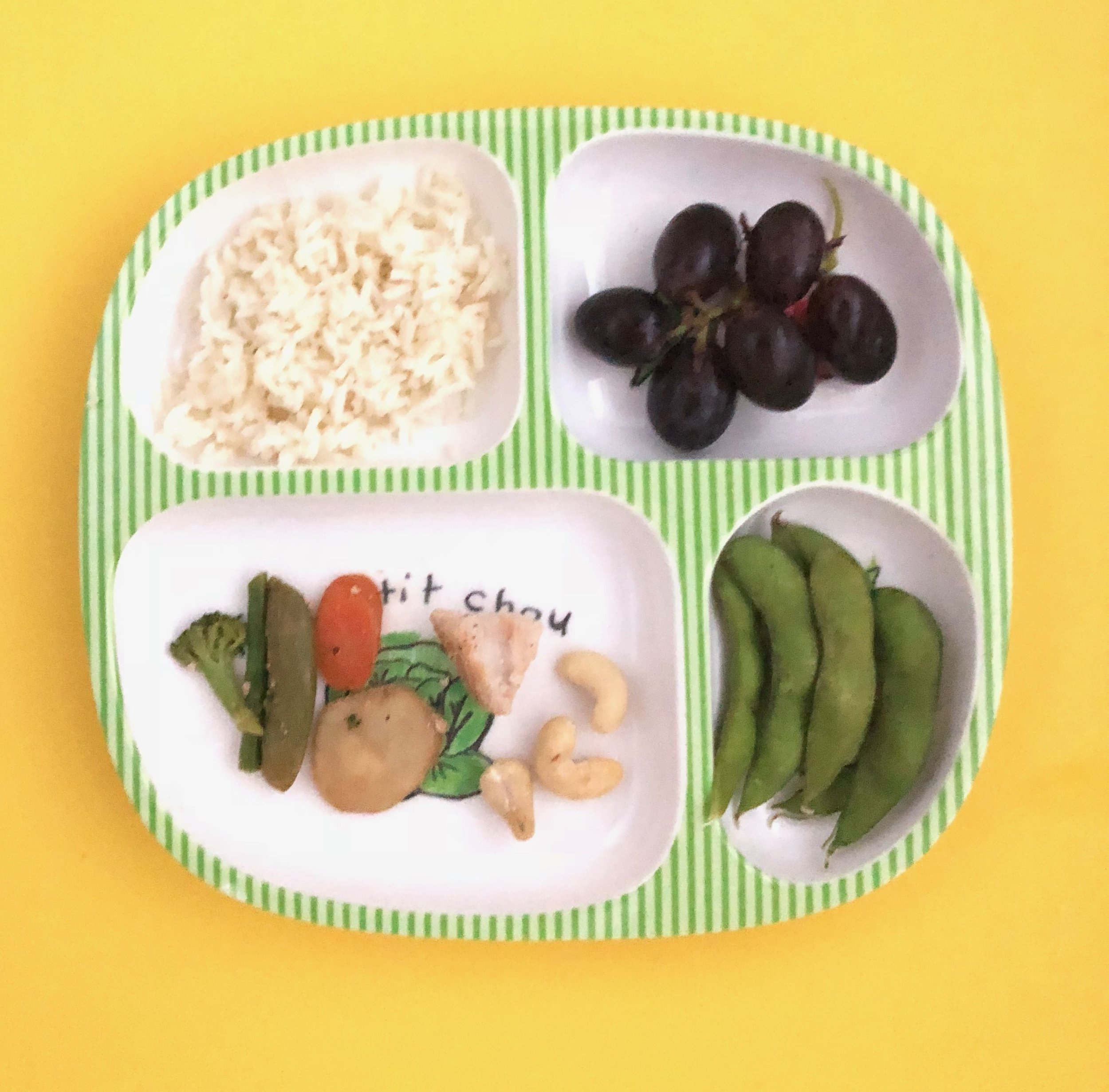 Kid's Plate from dinner: cashew chicken, rice, edamame, and grapes