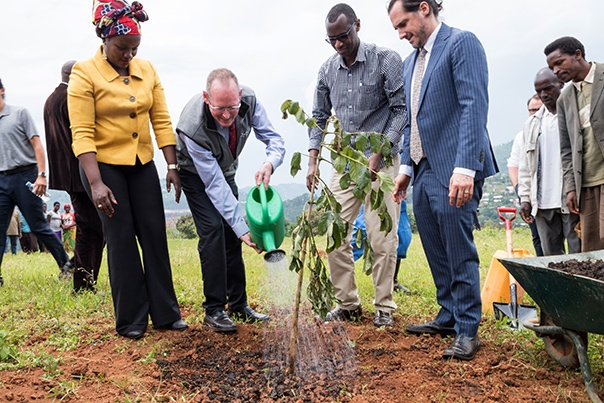 Left to right: Deputy Executive Director of Inshuti Mu Buzima Antoinette Habinshuti, PIH Co-founder Paul Farmer, Minister of Education Musafiri Papias Malimba, and Executive Director of the University of Global Health Equity Peter Drobac plant a tree to celebrate the building of the university. Photo by Aaron Levenson