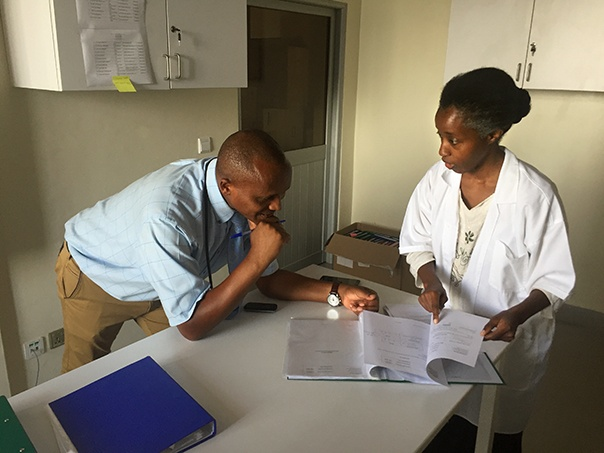 Dr. Fabienne Shumbusho consults with Dr. Jules Kabahizi, the head internist at Rwanda Military Hospital. Photo by Aaron Levenson
