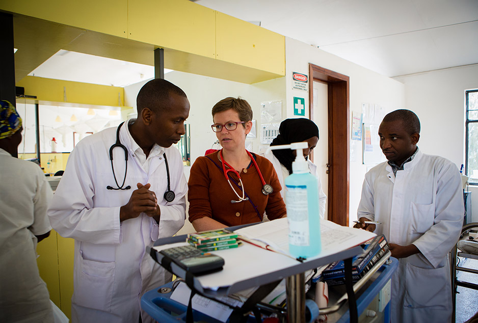 Dr. Alexis Manirakiza (left), one of the ward's two pediatric oncologists, listens to a question from clinical officer Dr. Grace Dugan. At right is Dr. Jean Pierre Bucyanayandi, a pediatric resident. Photo by Cecille Joan Avila