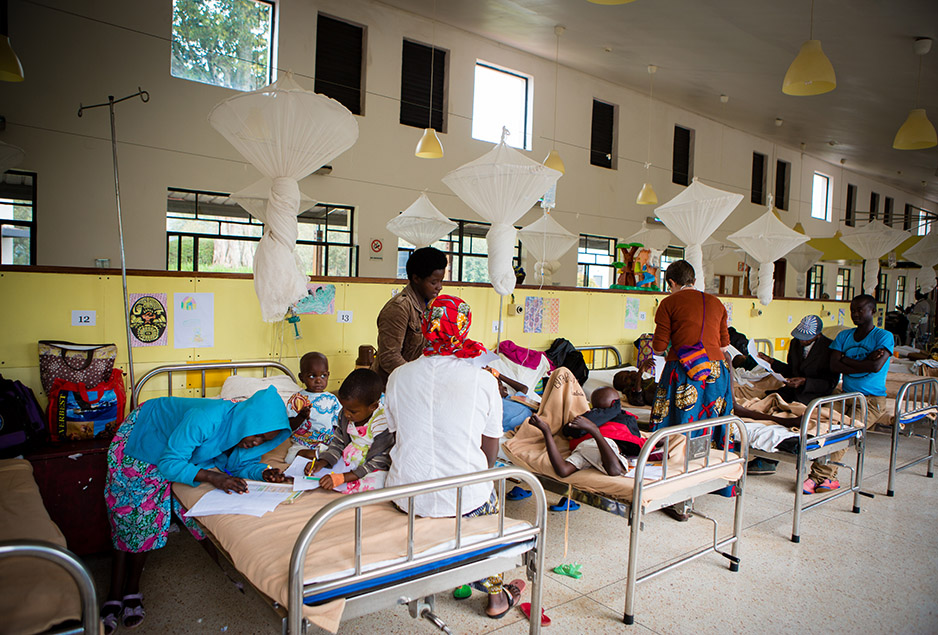 Inside the pediatric ward at the Butaro Cancer Center of Excellence, a PIH-supported facility at Butaro District Hospital in rural northern Rwanda. Children in the ward often mix in schoolwork, activities, and playtime between treatment and checkups. Photo by Alex Coutinho