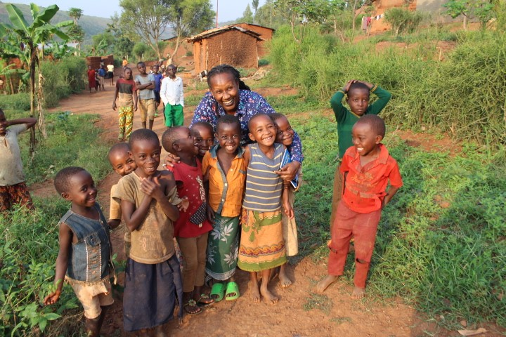 Alice with children in Rwinkwavu after home visits