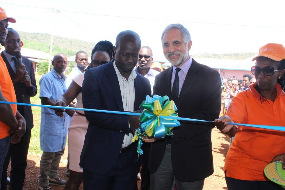 Dr. Gary Gottlieb, PIH CEO and the Vice Mayor of Kirehe District cutting the ribbon to Cyambwe Health Post