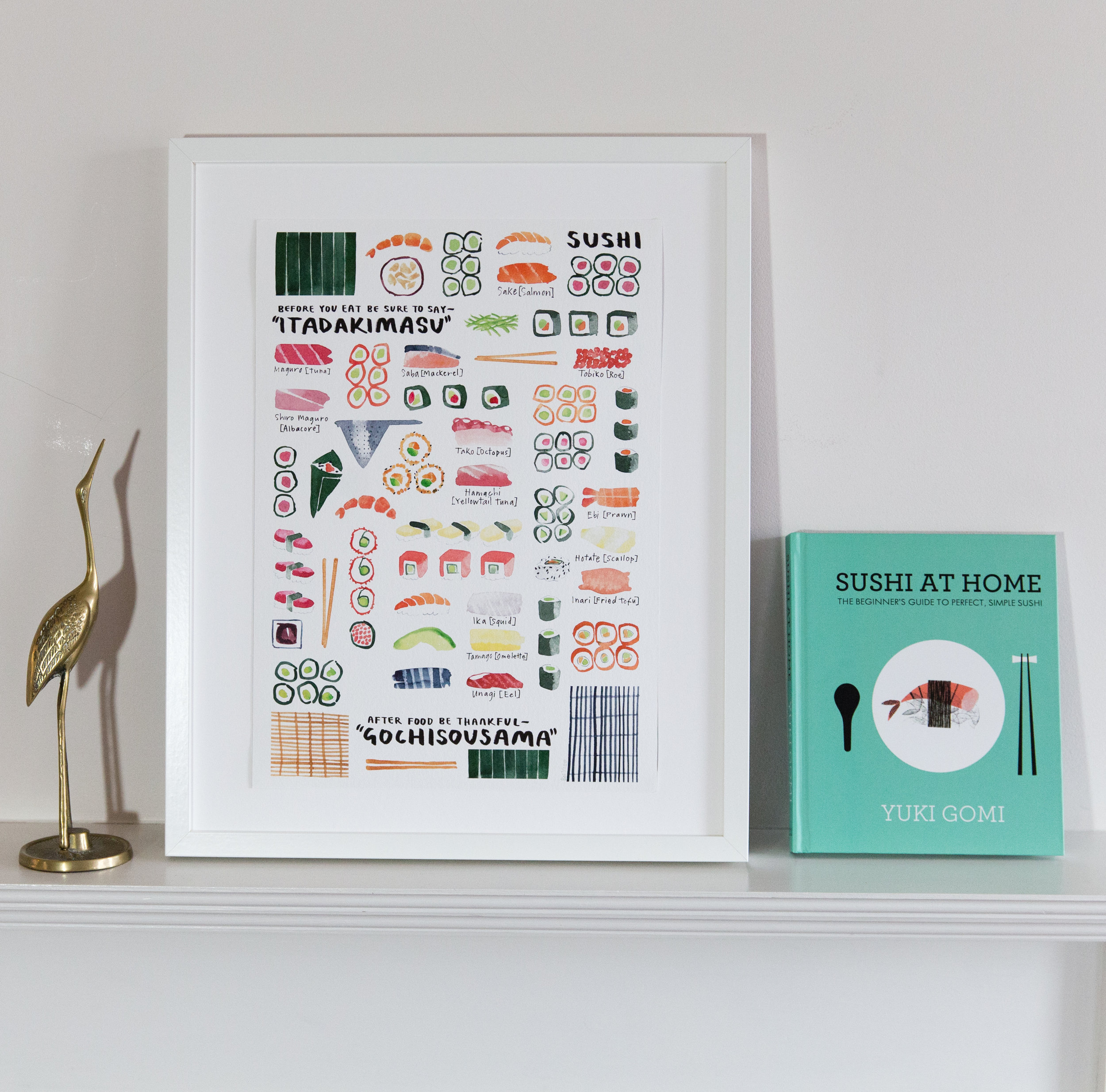 "My 'Eat Sushi"" Art Print £20 (A4), £40 (A3) next to Yuki's ""Sushi at Home"" book"