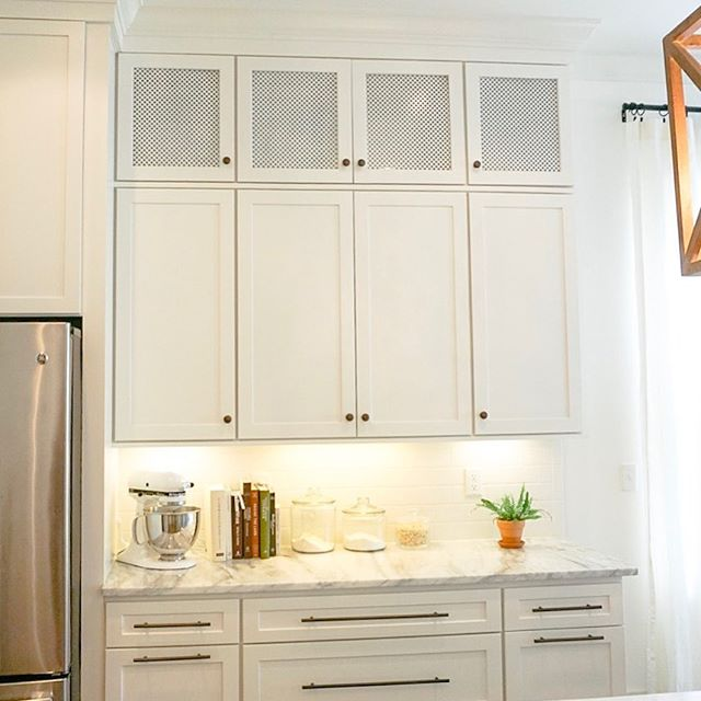 Weekend project: we took out the clear glass from our upper cabinets and replaced it with decorative sheet metal painted white! I love the new vibe!! Thoughts?! #letsgowithlayla thanks for the idea!!!! #homedecor #kitchen #update