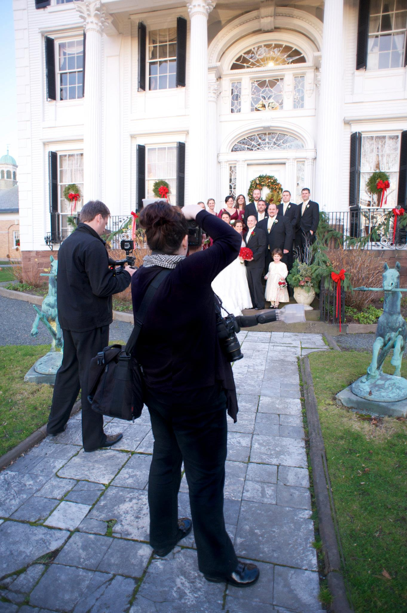 Amber and her cinematography shoot crew shooting a wedding at Linden Place, Bristol, Rhode Island.