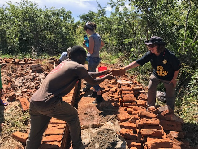 Ezekiel with Helen and Charlotte - building the new bathroom.