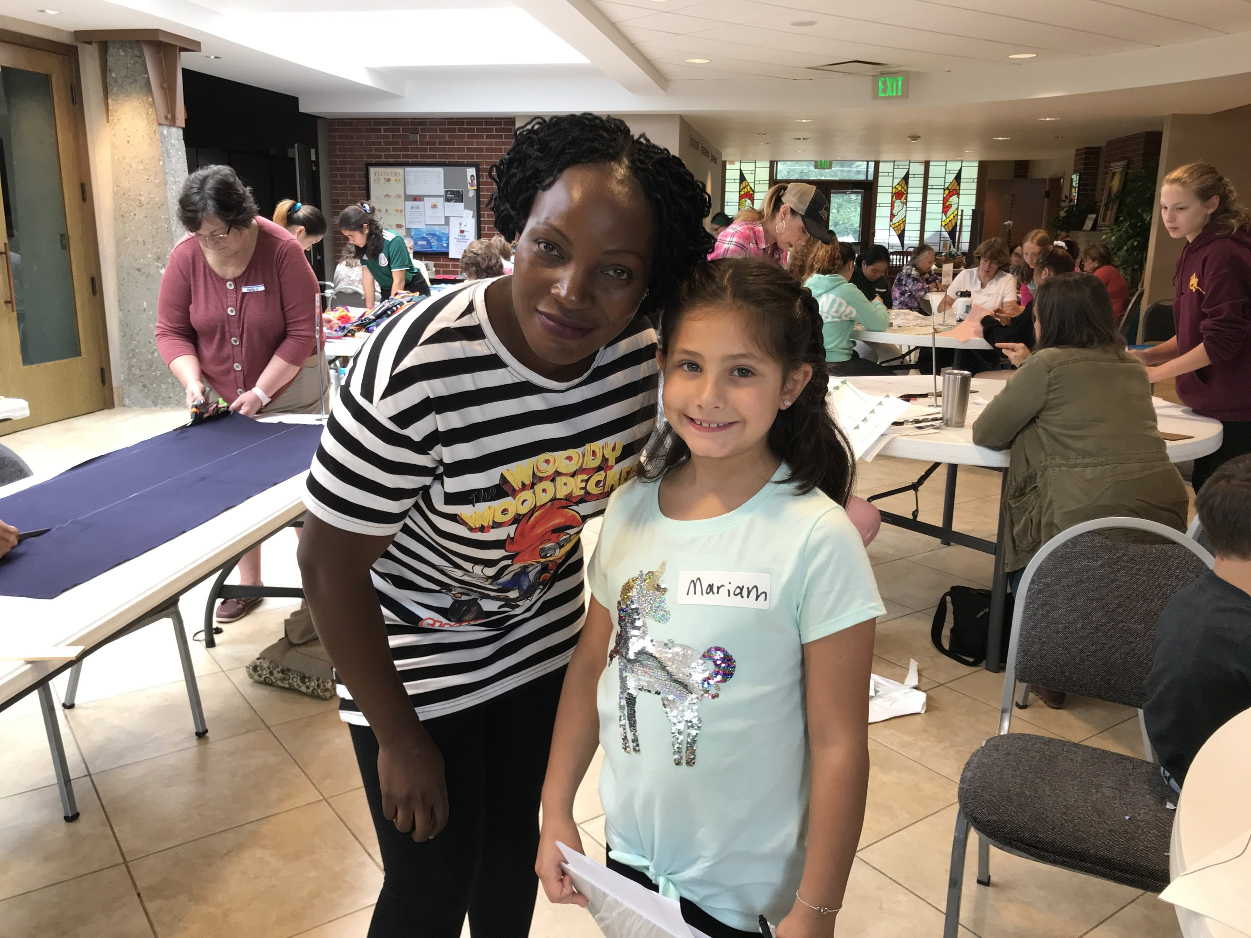 Phoebe and a young volunteer at the Calvary Methodist Church MoonBee a few weeks ago.