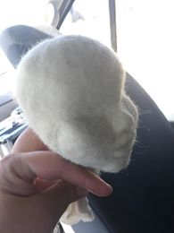After many hours of STABBING and stabbing that sucker with your felting needle you can shape and form it into a nice little face.