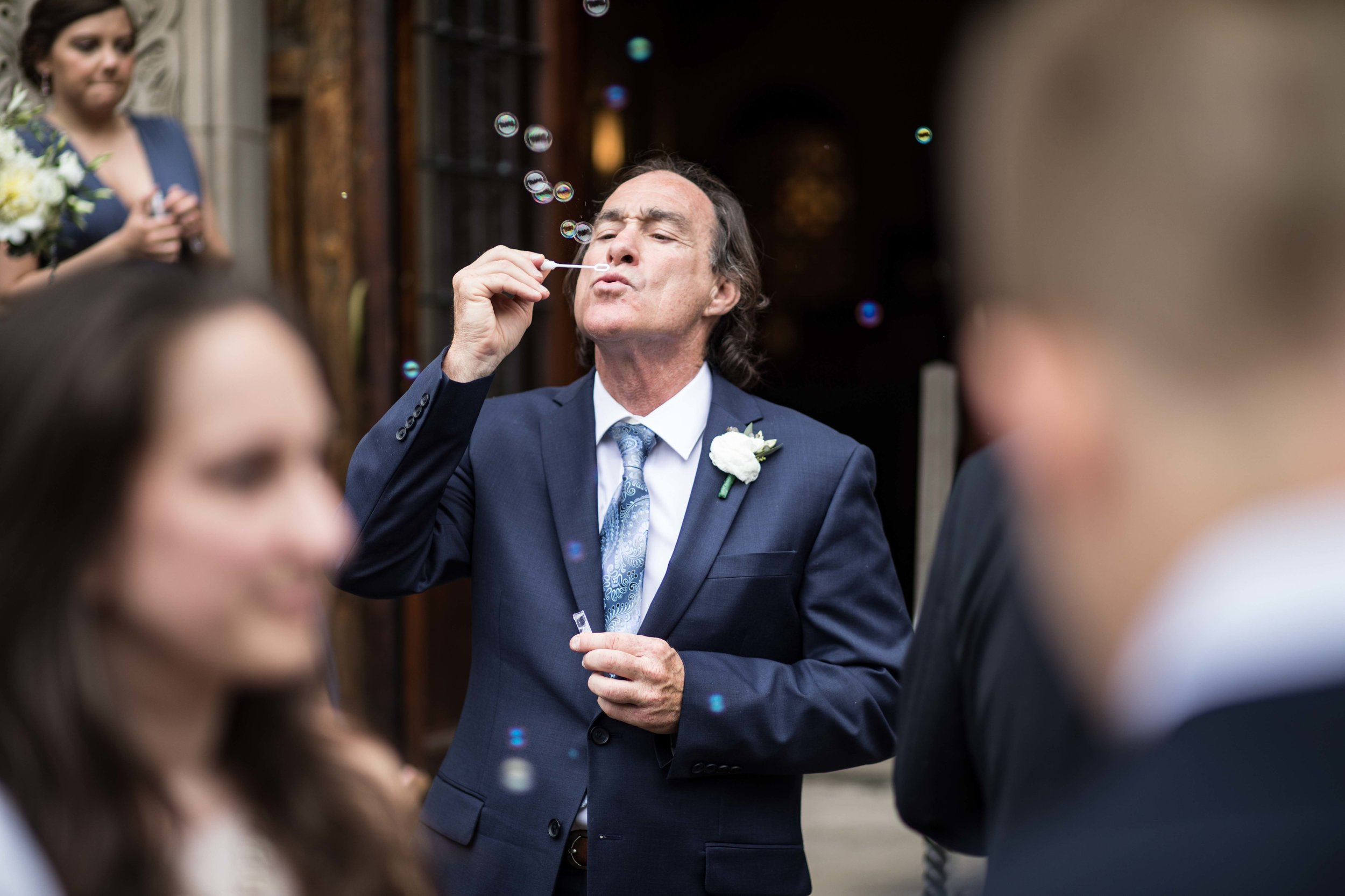Father of the Groom testing bubble wand