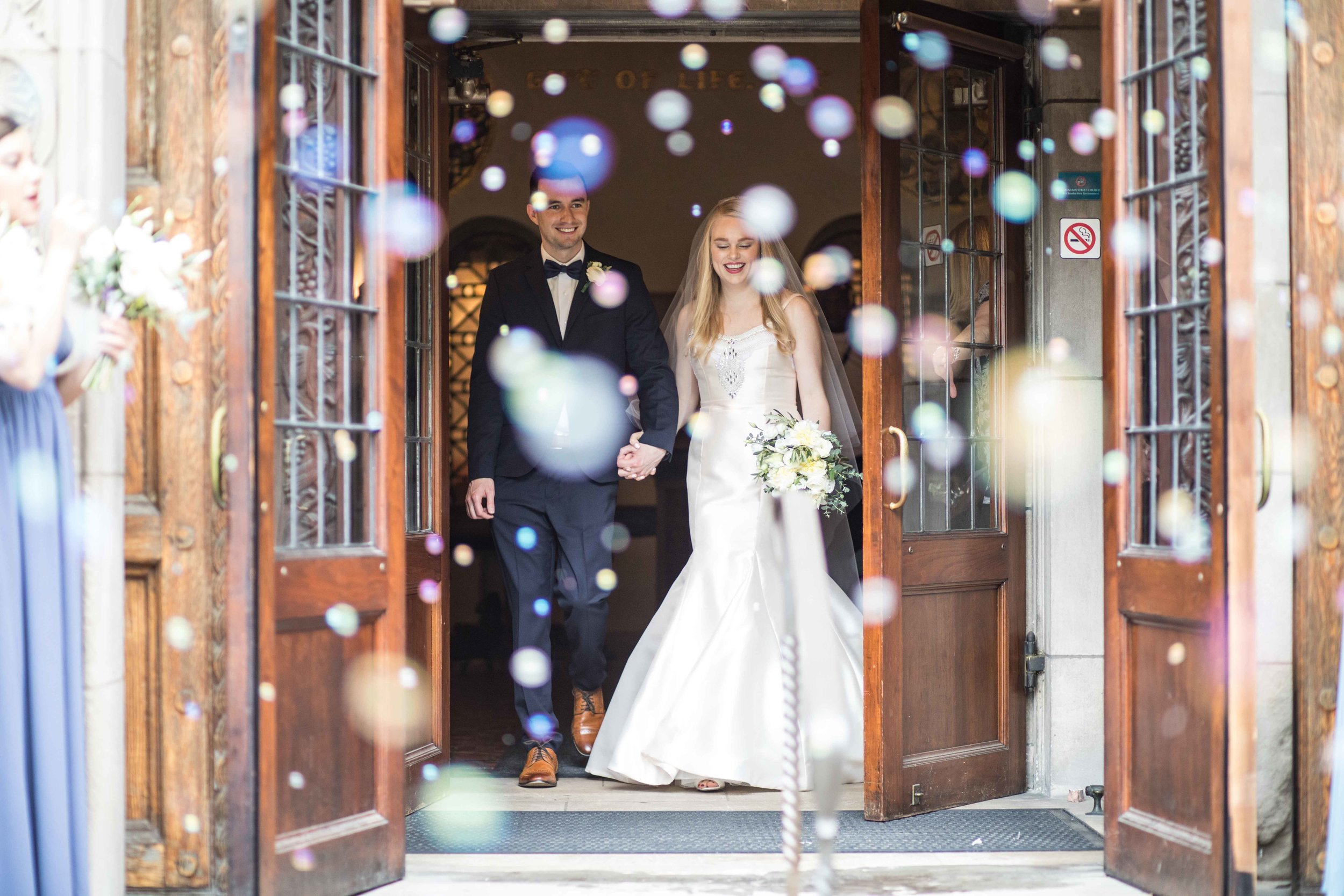 Bride and Groom in a cloud of bubbles
