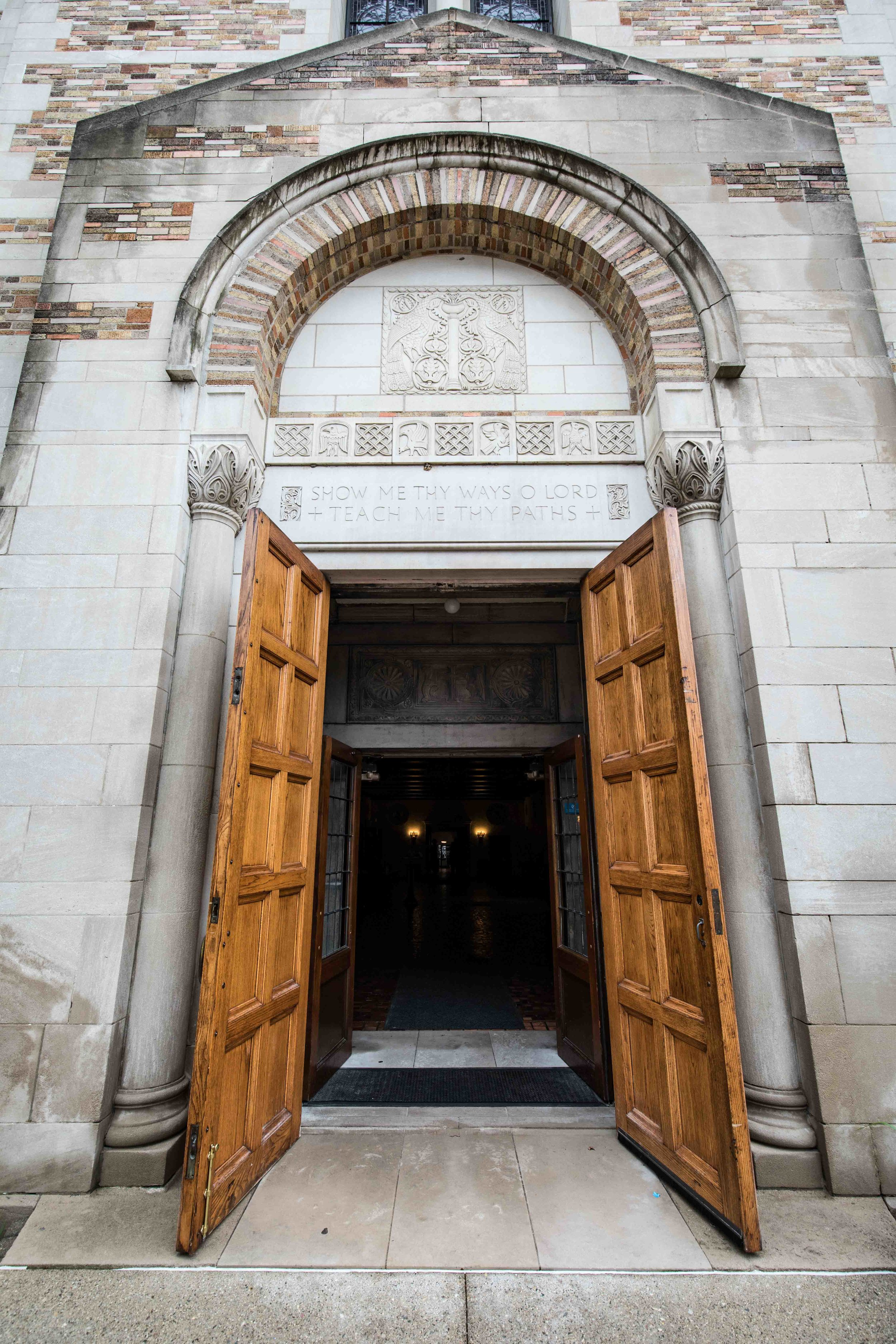 Tall wooden church doors