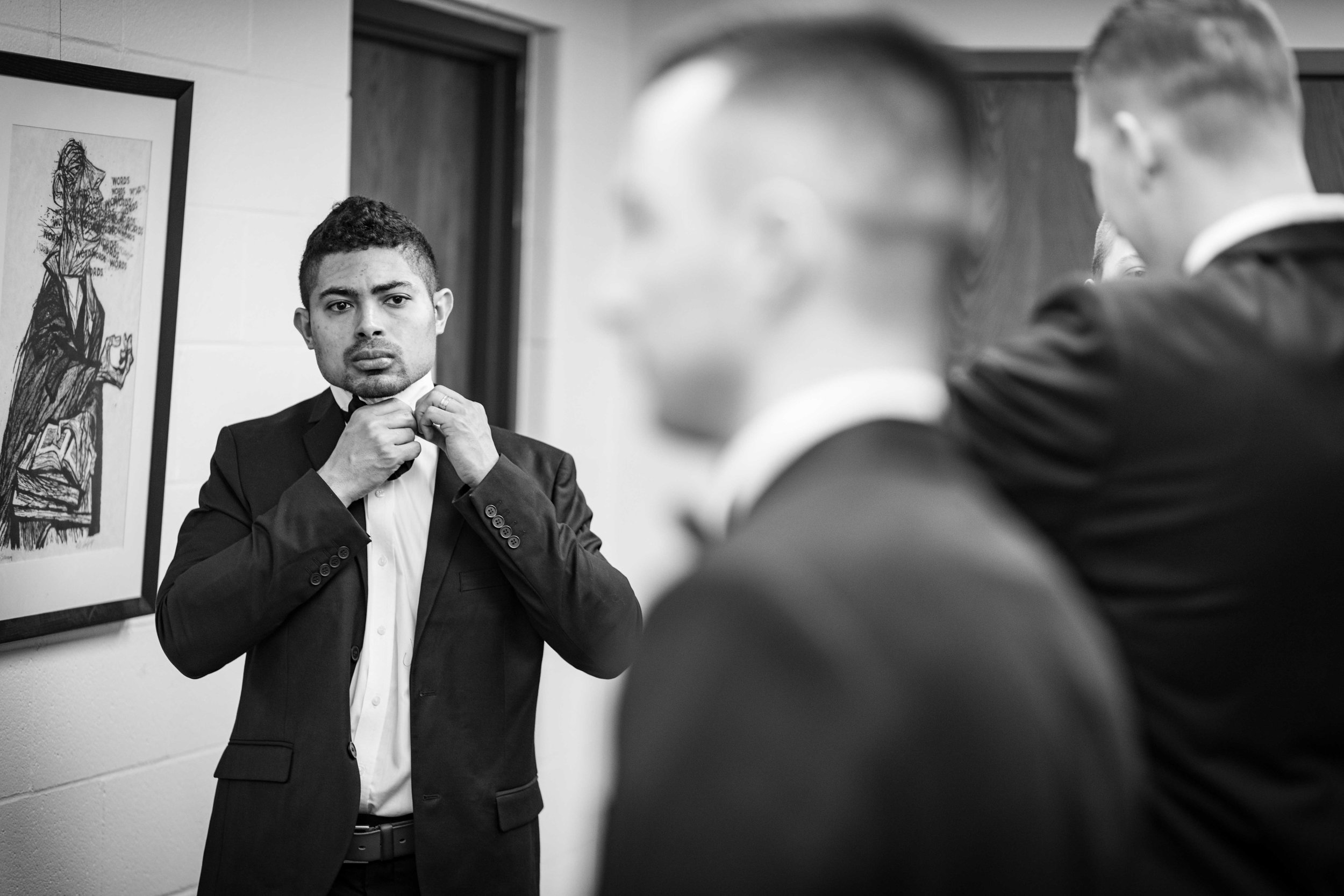 Groomsmen fixing tie and getting ready for the ceremony