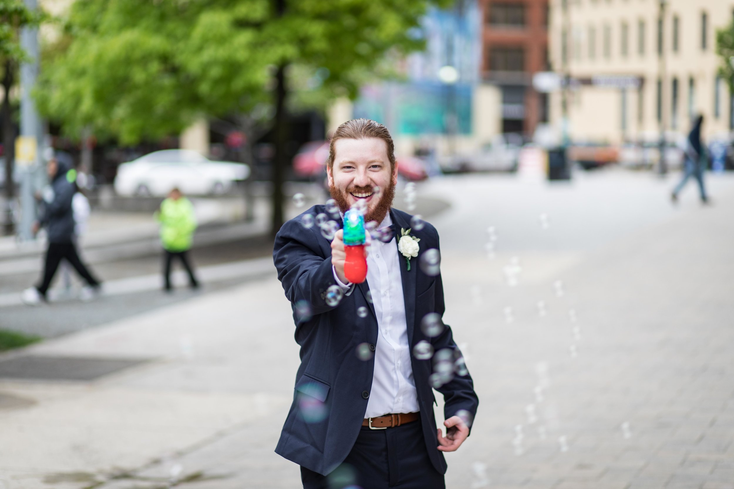 Wedding usher with bubble gun on the streets of Grand Rapids