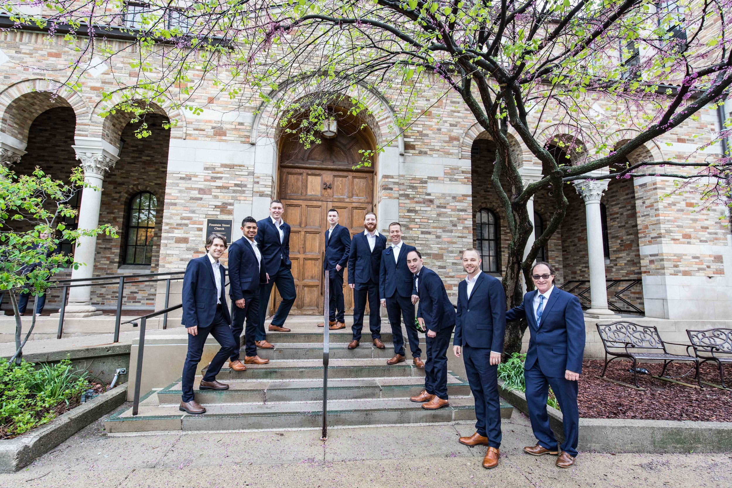 The Groomsmen posing on the steps of the church