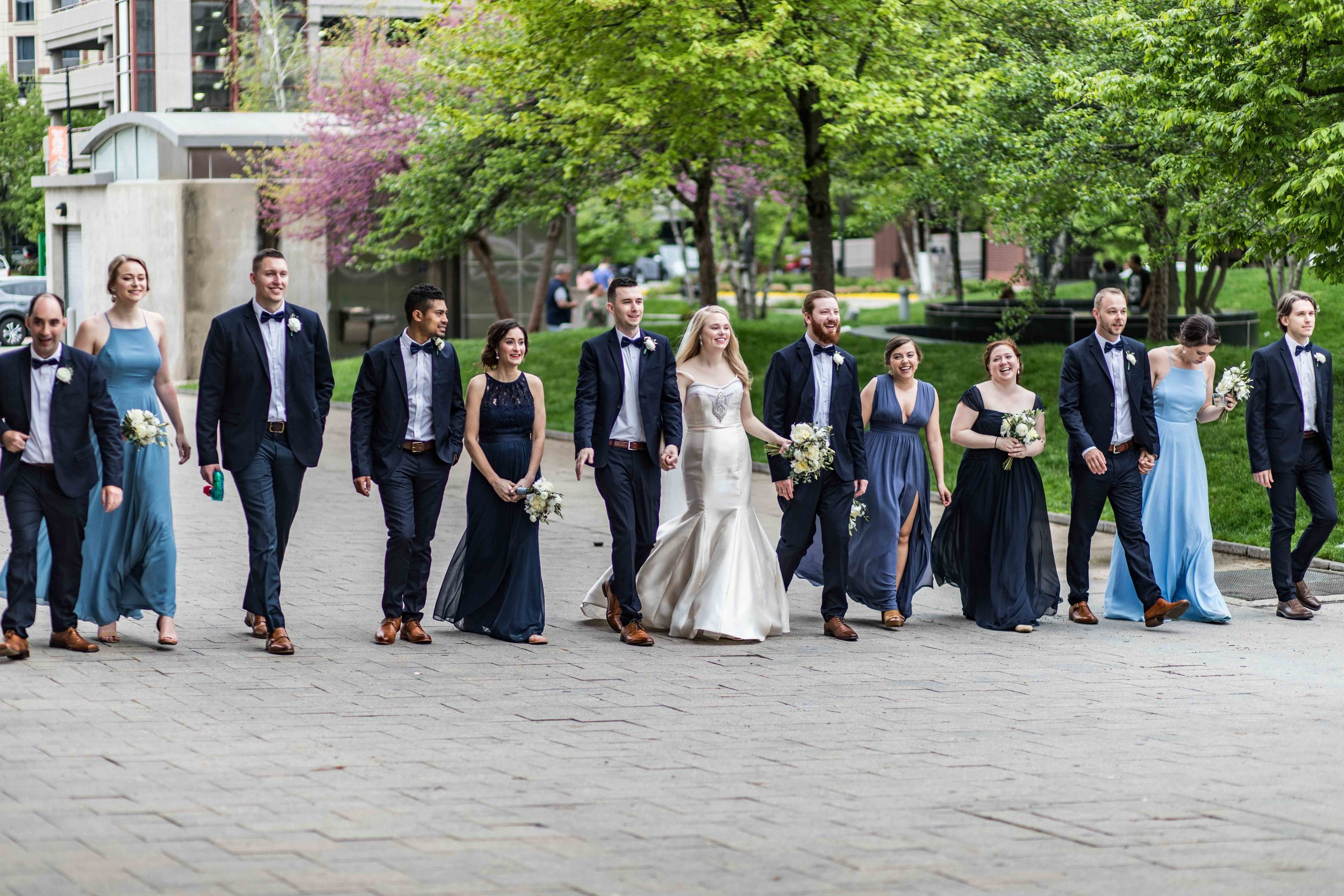 Wedding party walking downtown Grand Rapids