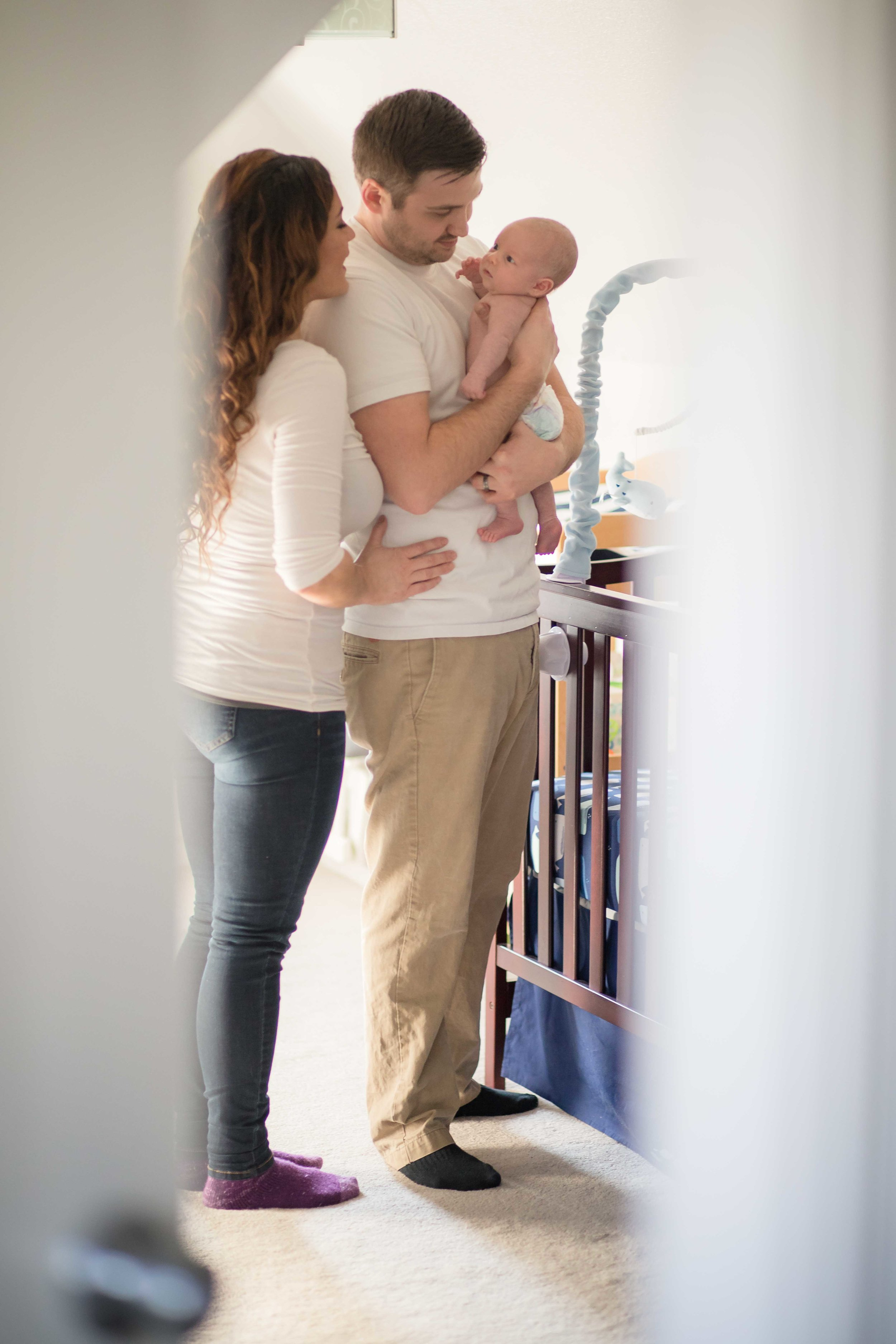 mother and father in newborns nursery