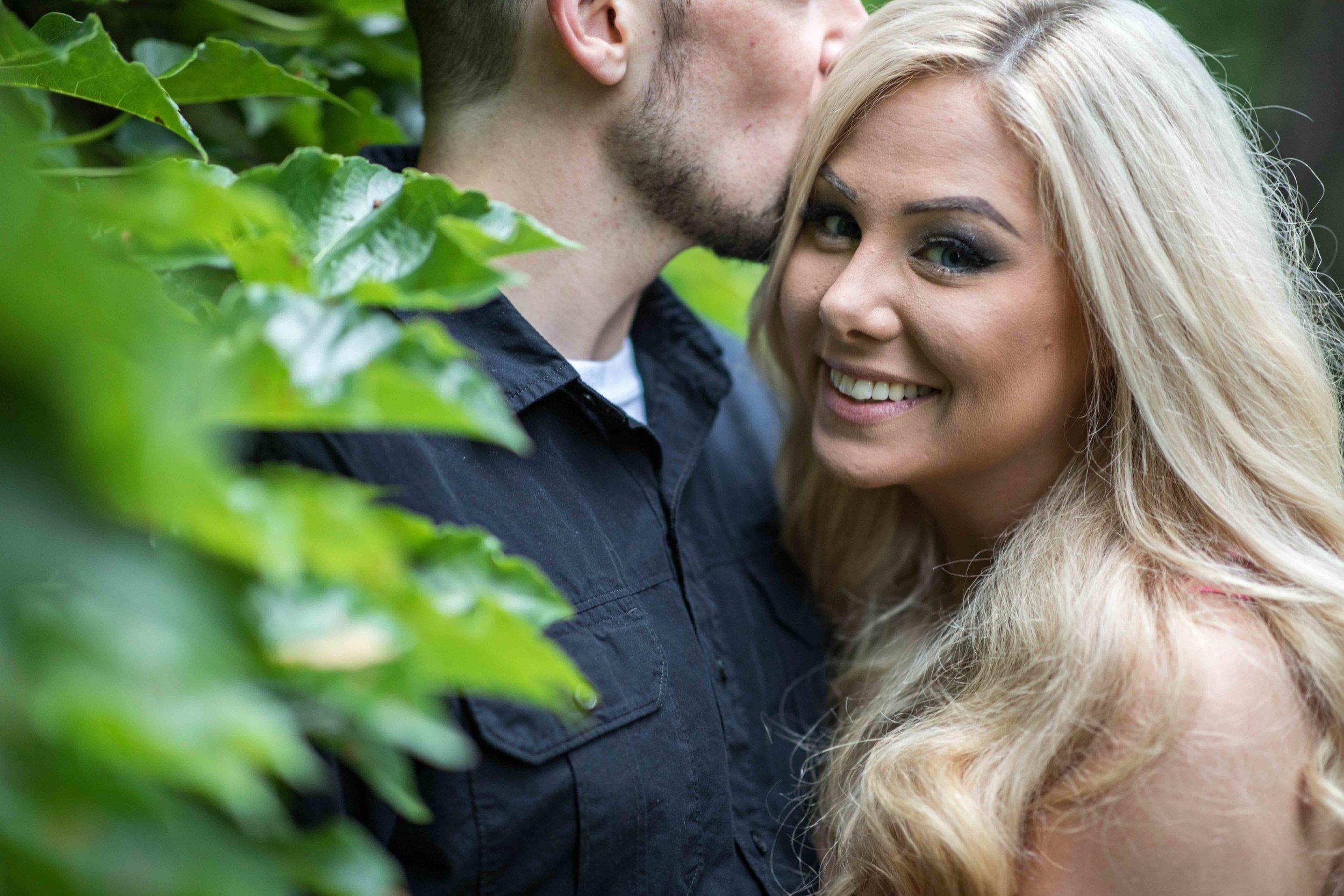 A hidden kiss in the ivy at Vandercook Hall in Kalamazoo Michigan