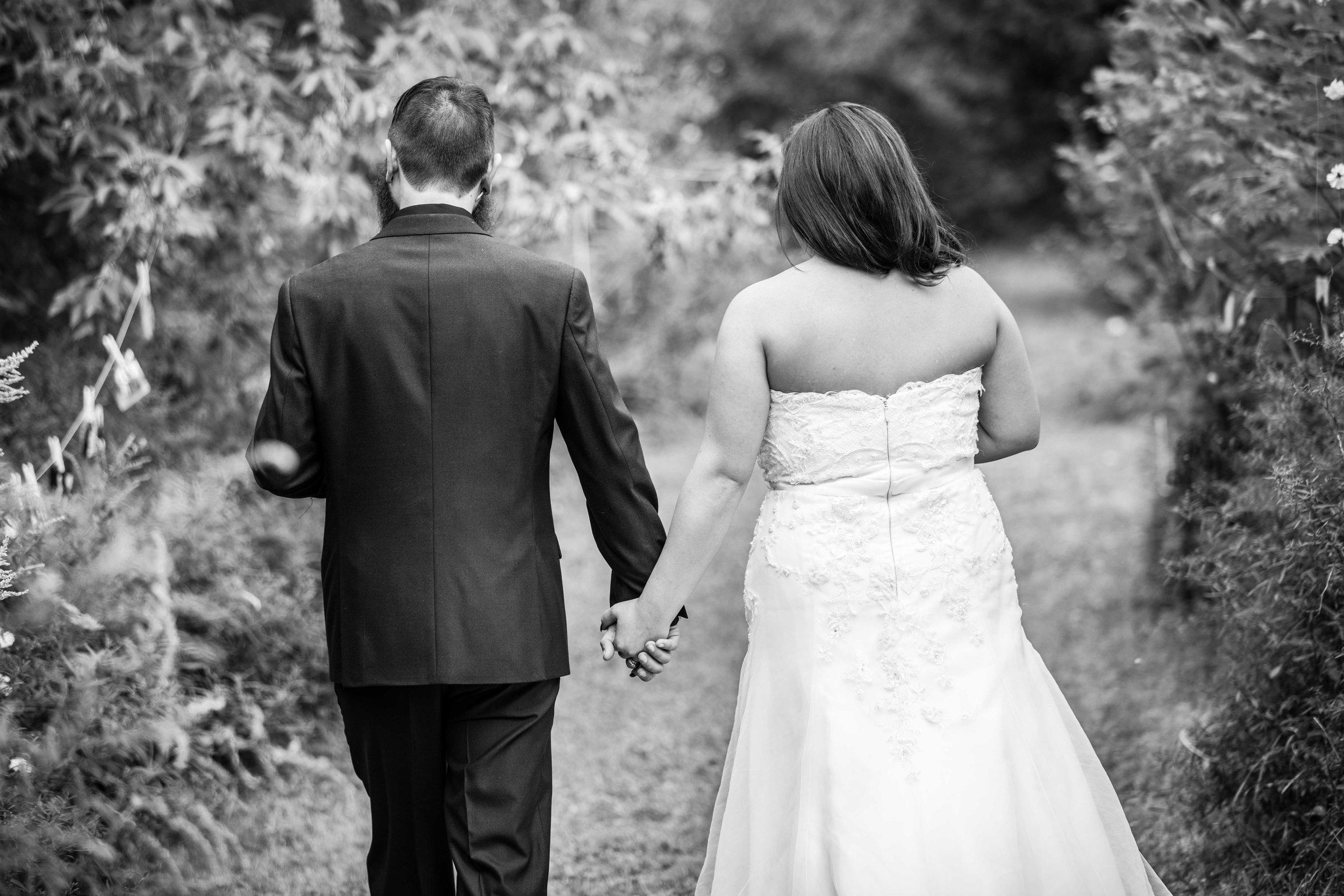 black and white bride and groom walking away.jpg