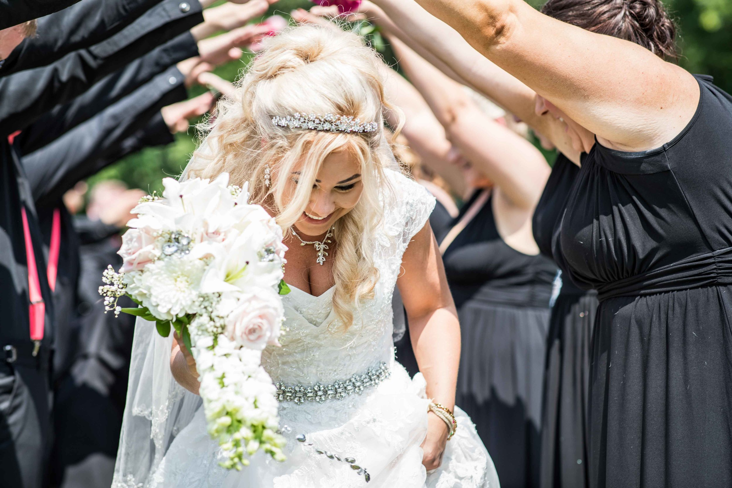 The new husband and wife run through a tunnel of their closest friends