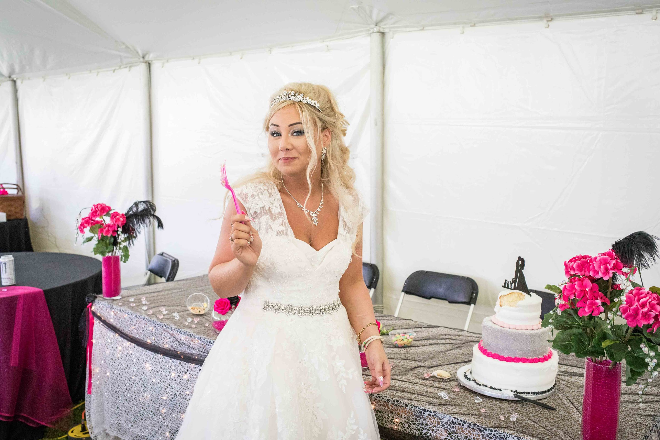 The bride taunts the camera with her pink fork and cake