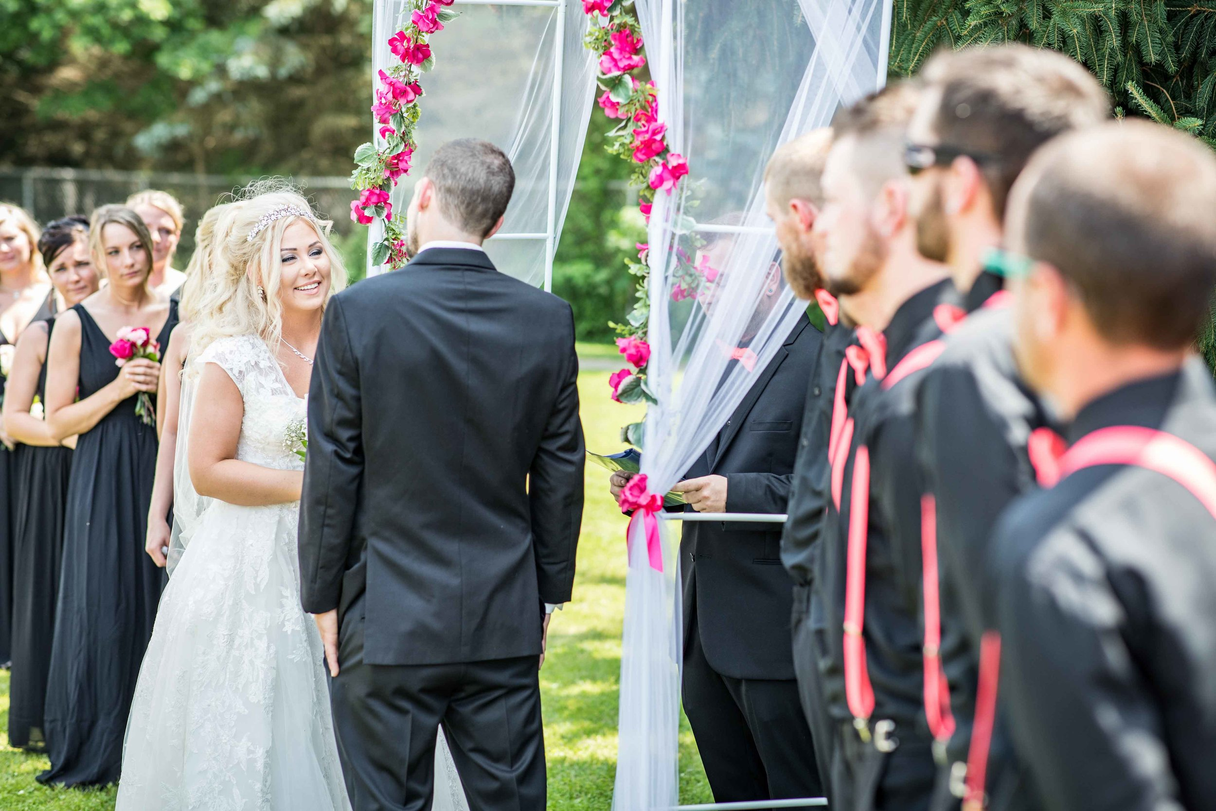 She listens and smiles as he says his vows