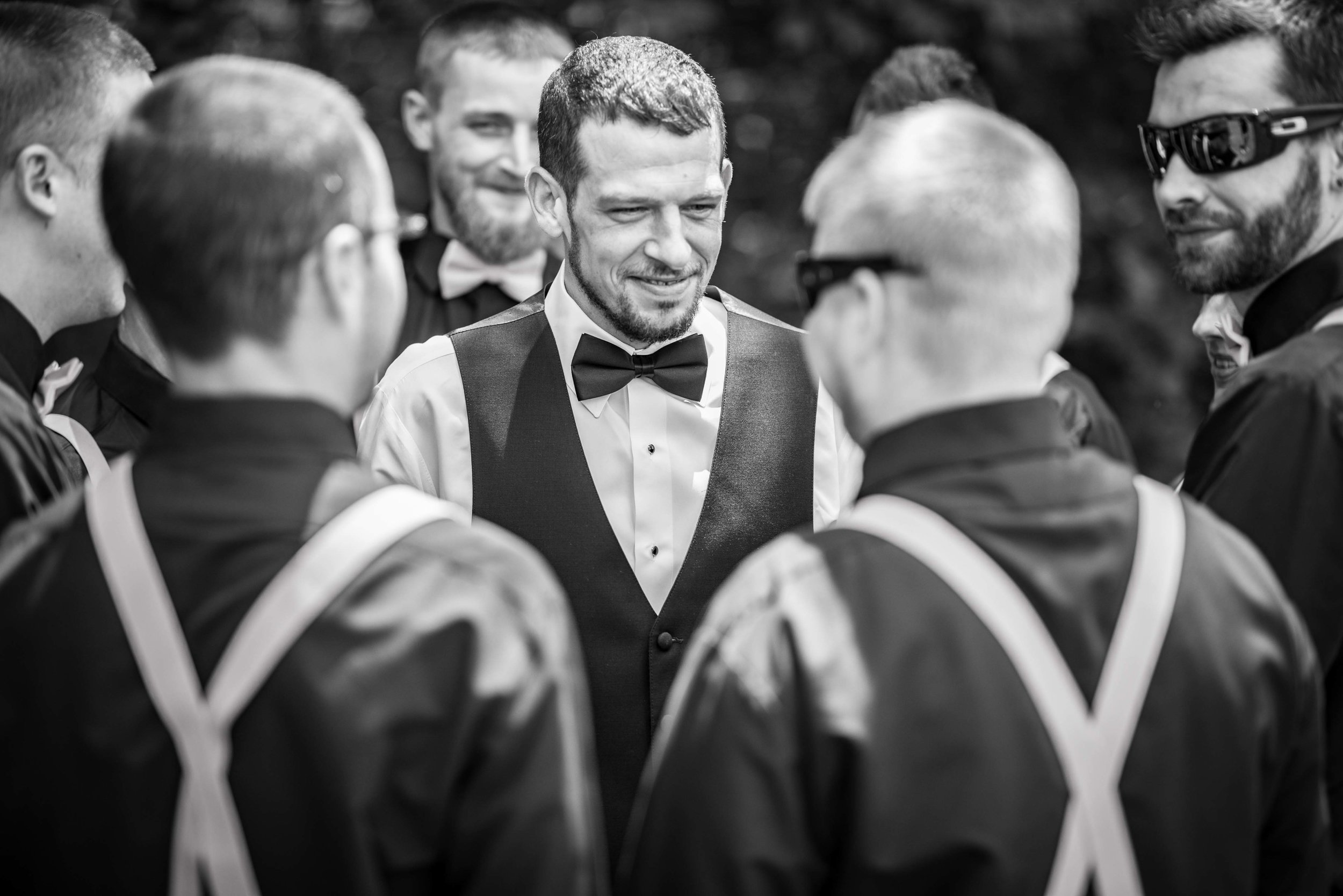 The Groom is surrounded by all his best friends