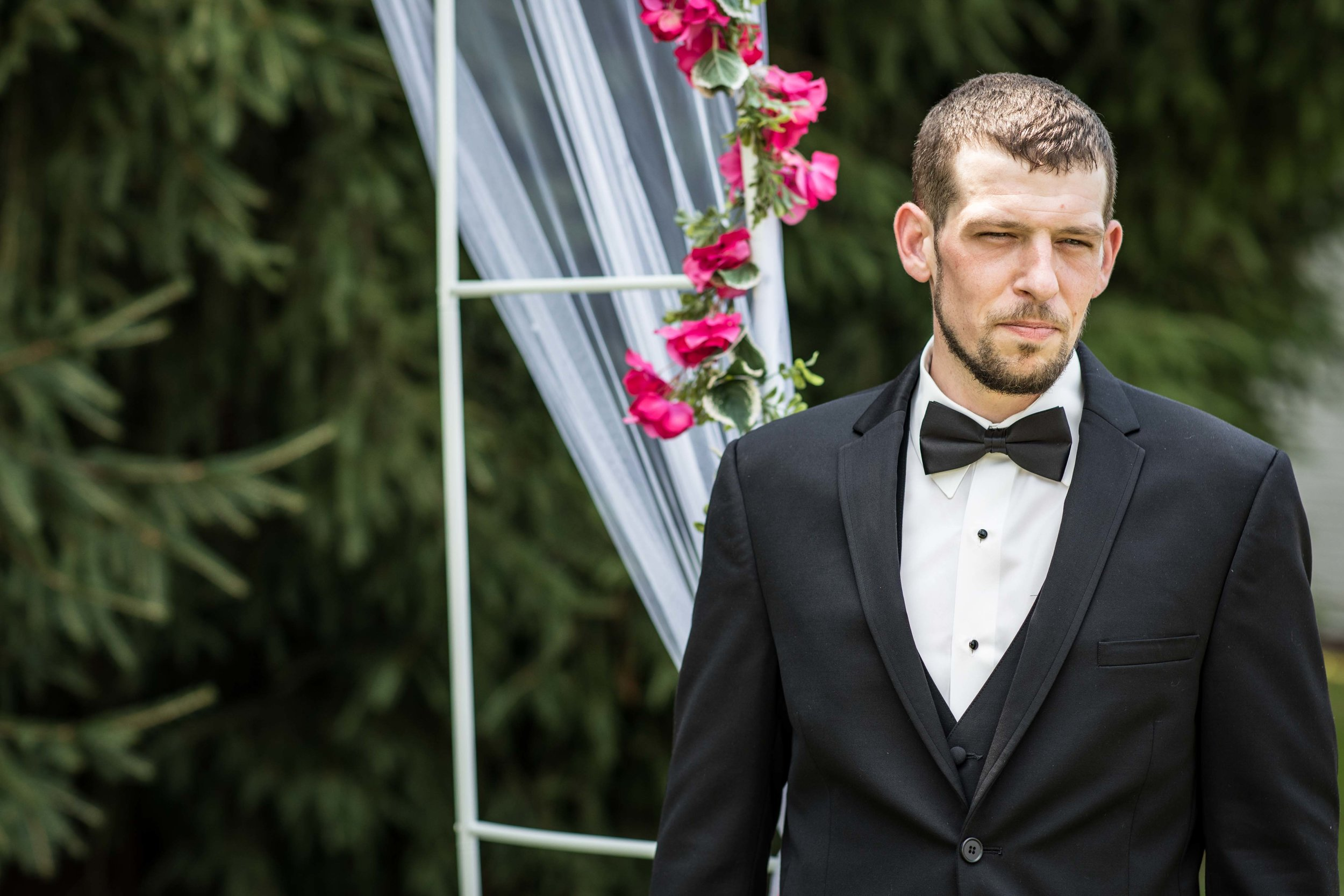 The groom patiently waits for his bride at the beginning of the ceremony