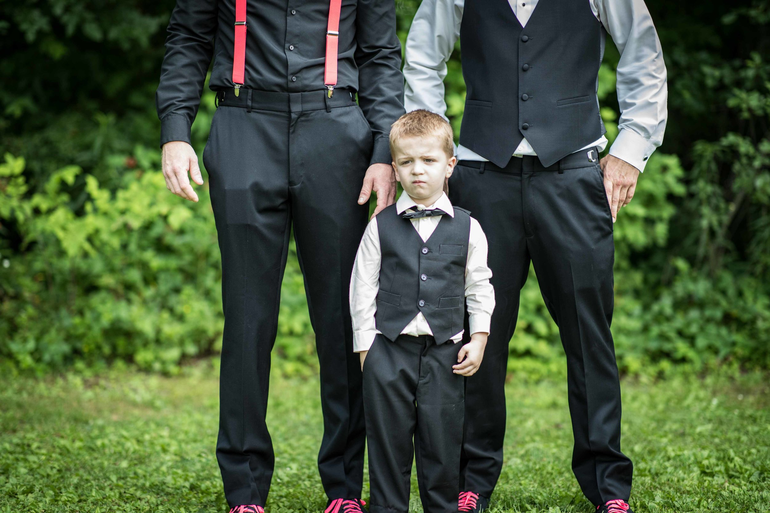 The shy ring bearer finally poses for a photo