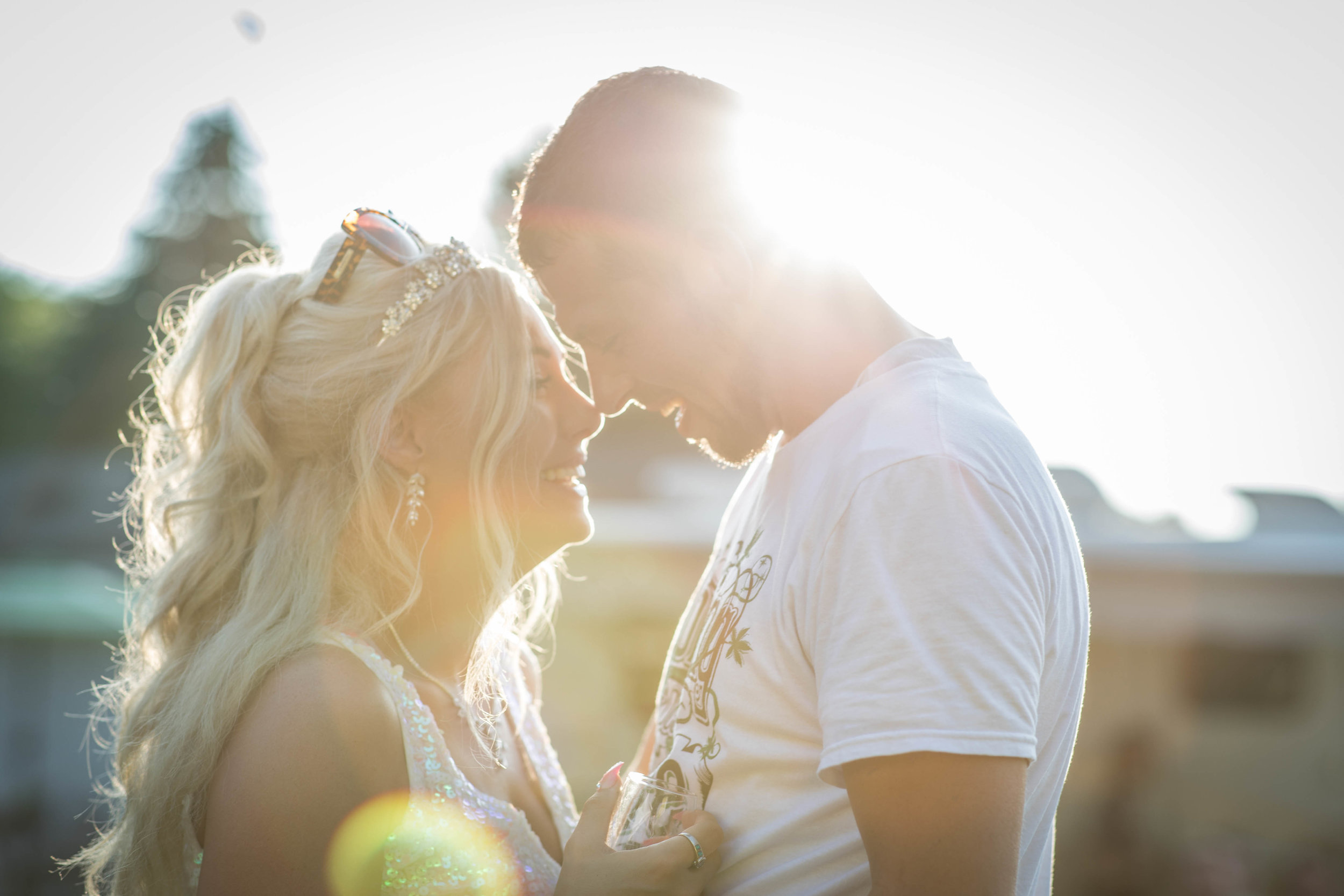 Bride and groom embrace in a setting sun