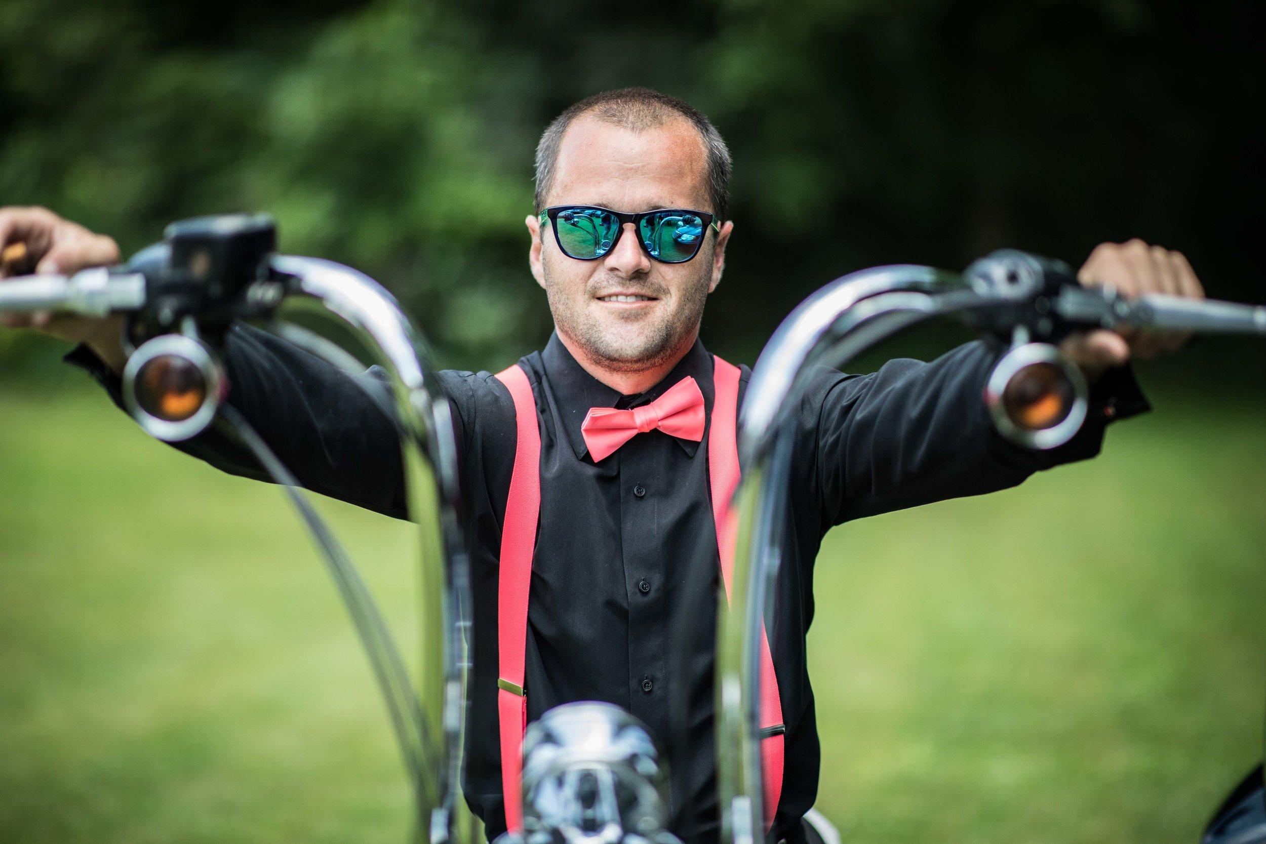 Groomsmen in pink suspenders on motorcycle.jpg