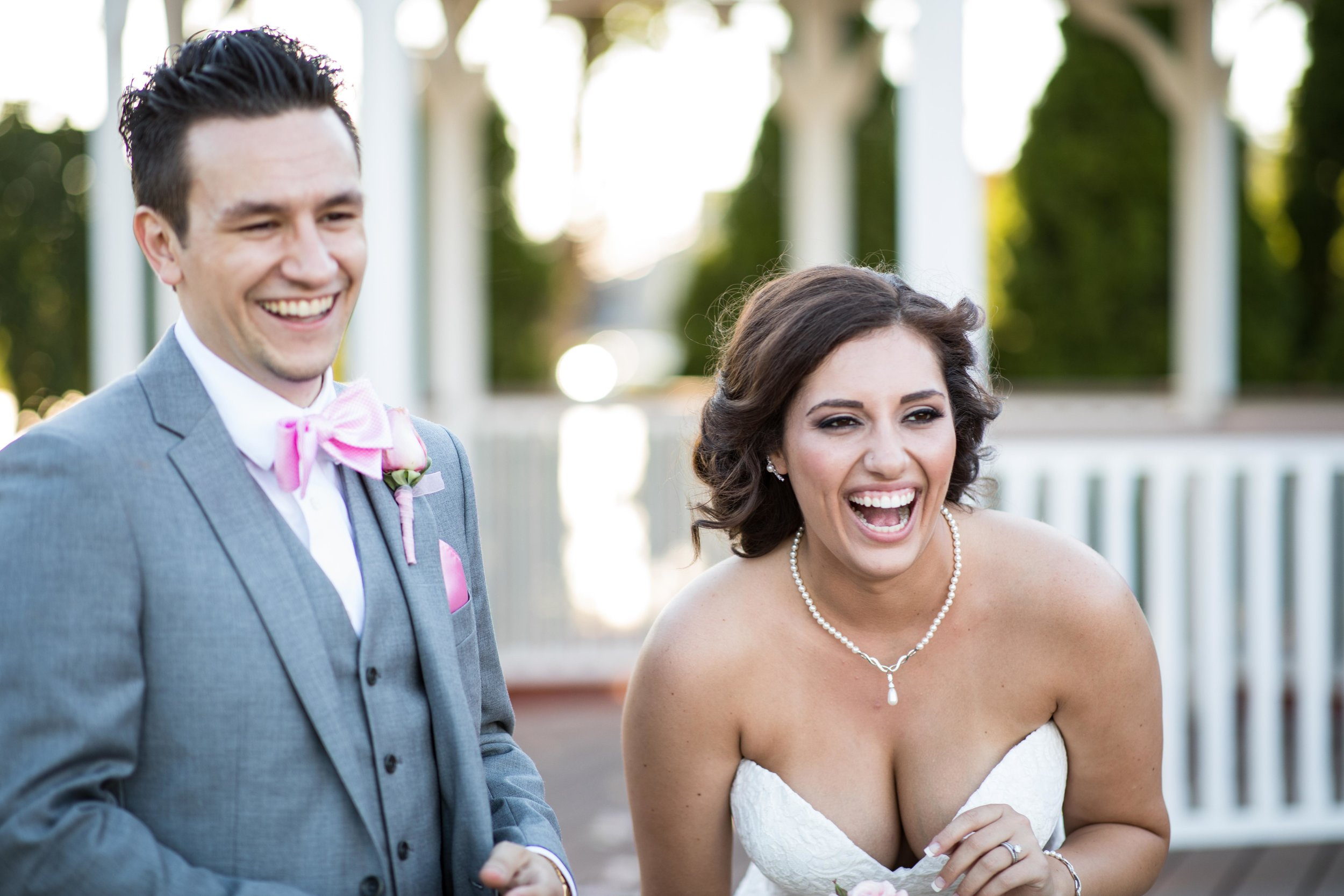 bride and groom laughing during portraits.jpg