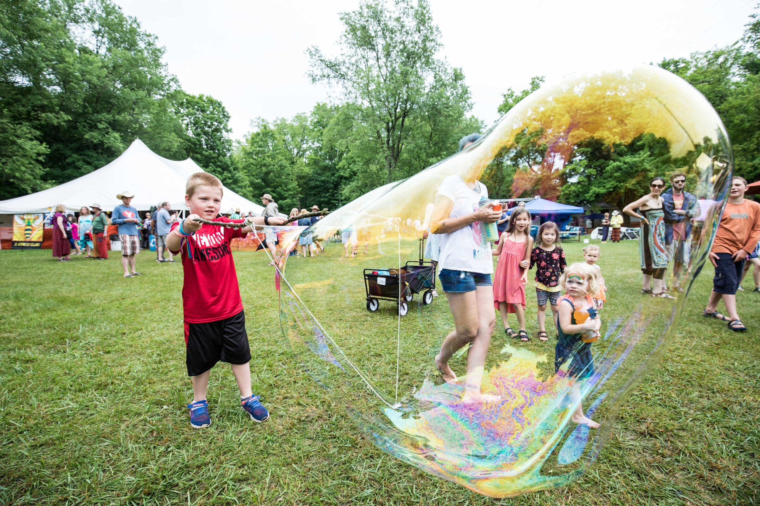 A kid making an enormous bubble