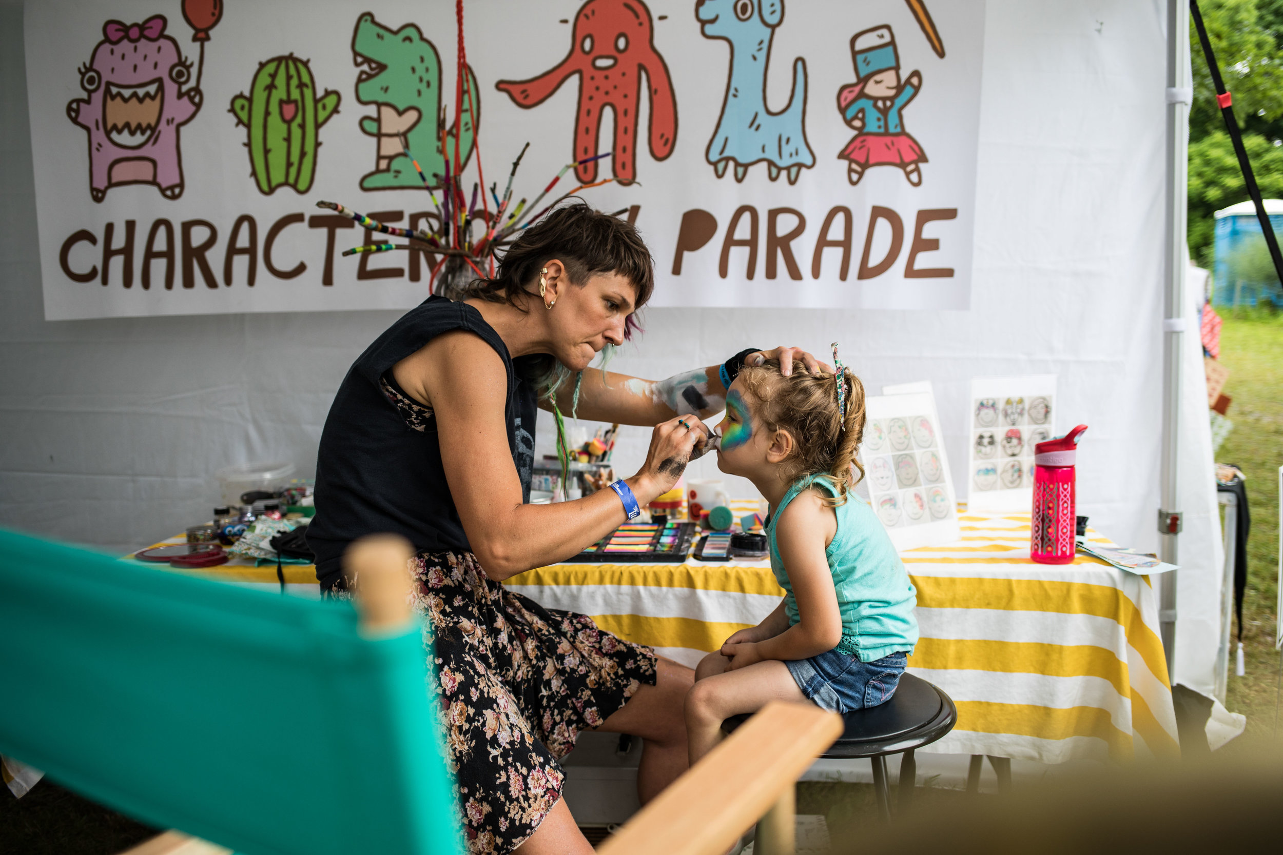 a small child getting her face painted