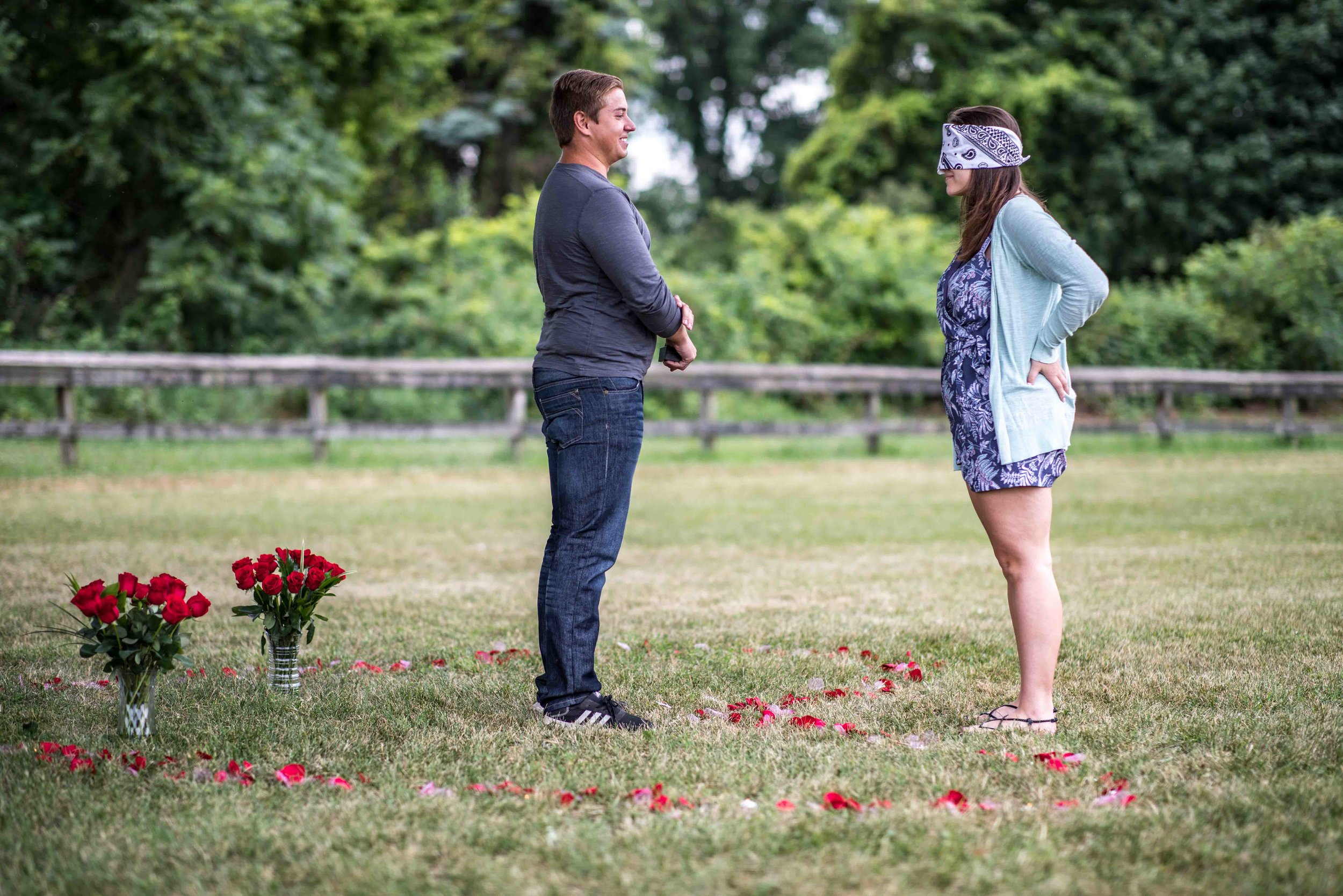 Boyfriend prepares to take a knee in front of his blindfolded girlfriend