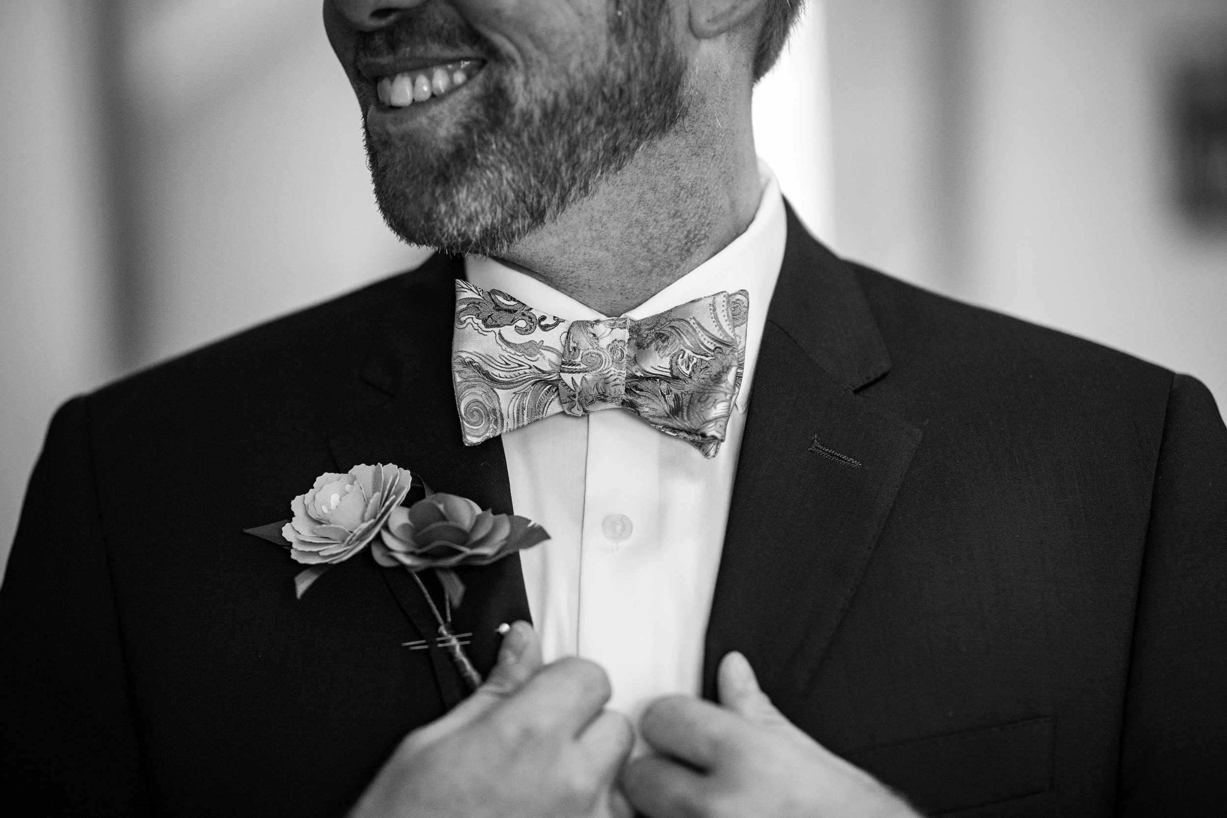 groom in bowtie getting ready
