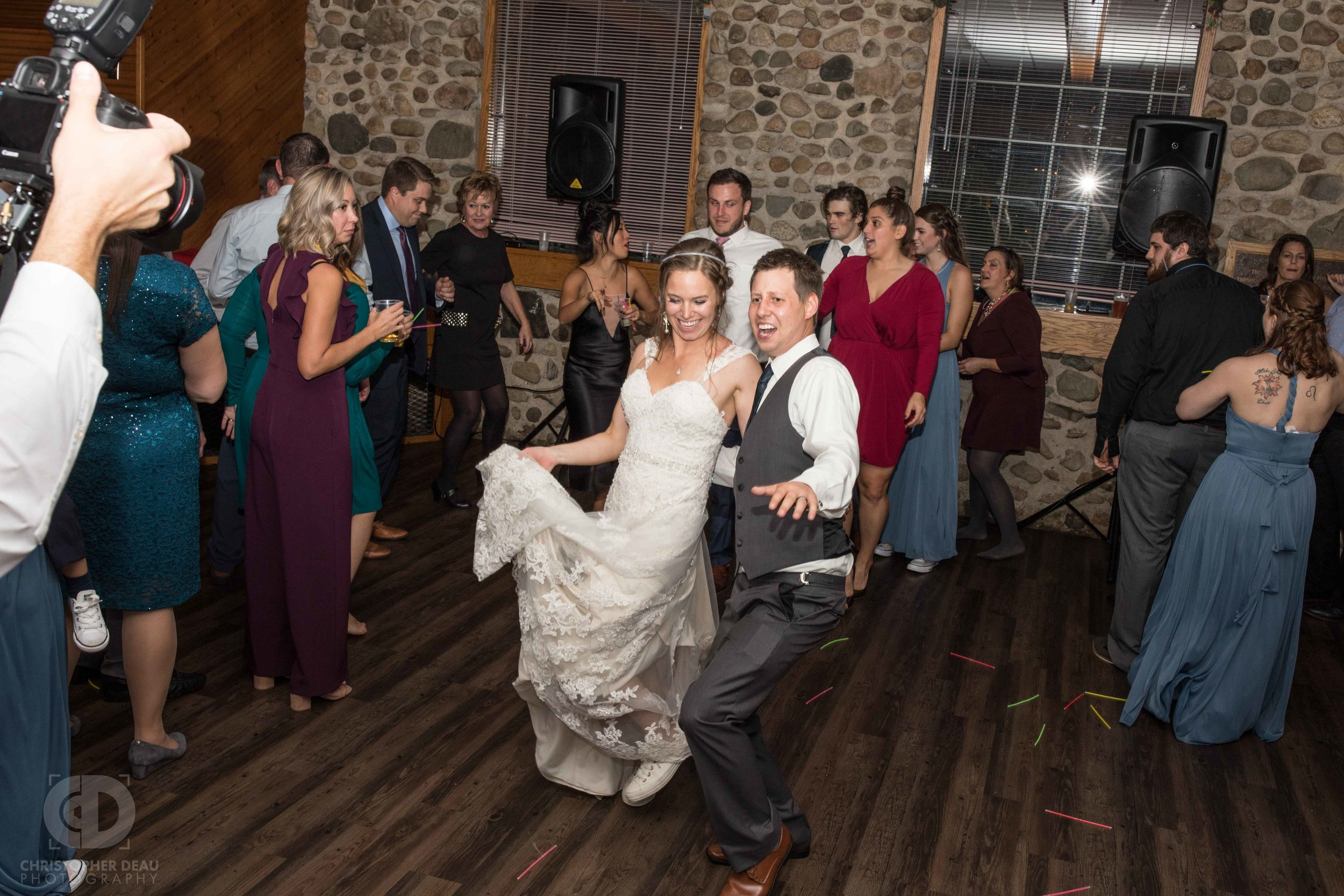 Bride and Groom dancing in a crowd during the reception