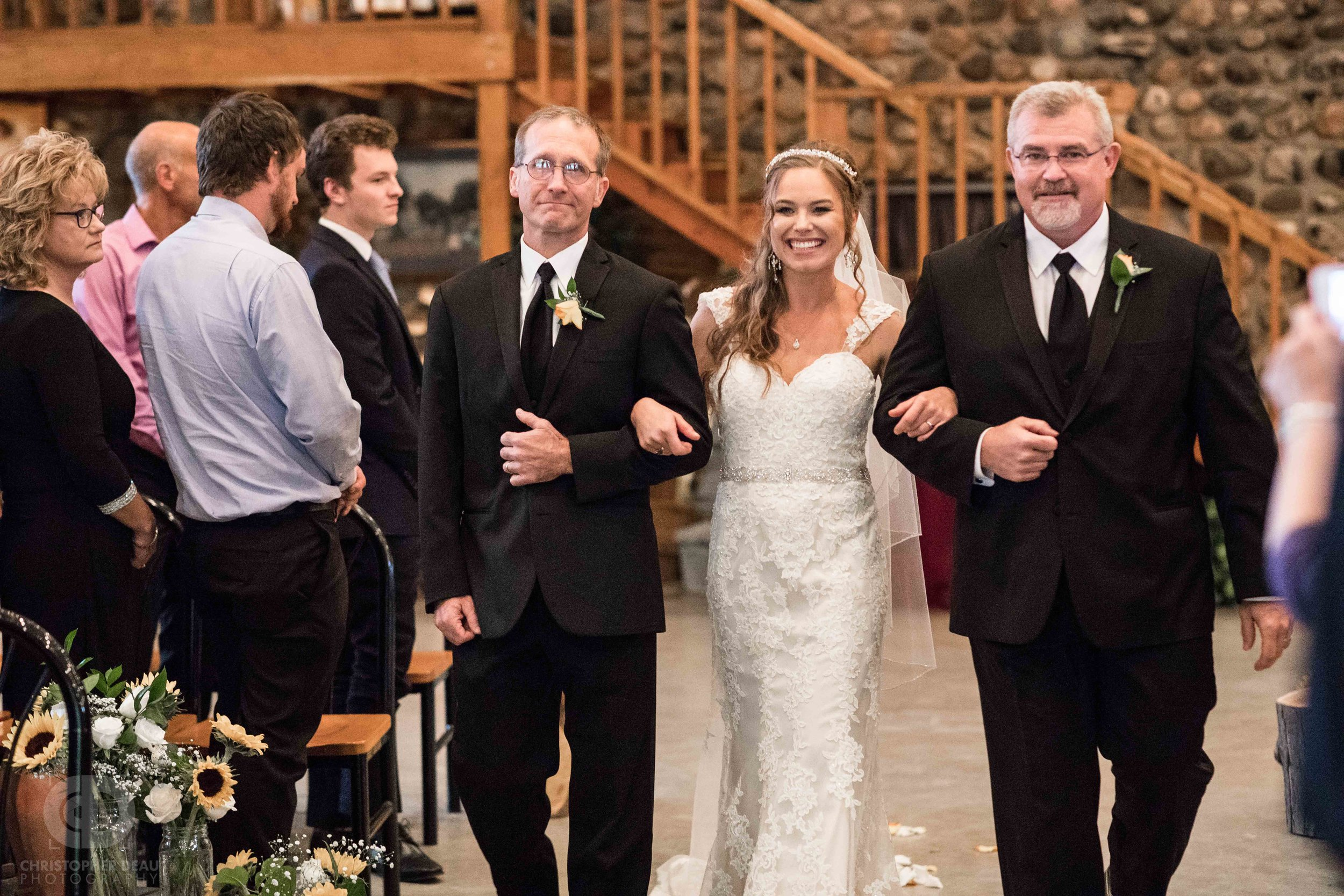 Bride being walked down the isle