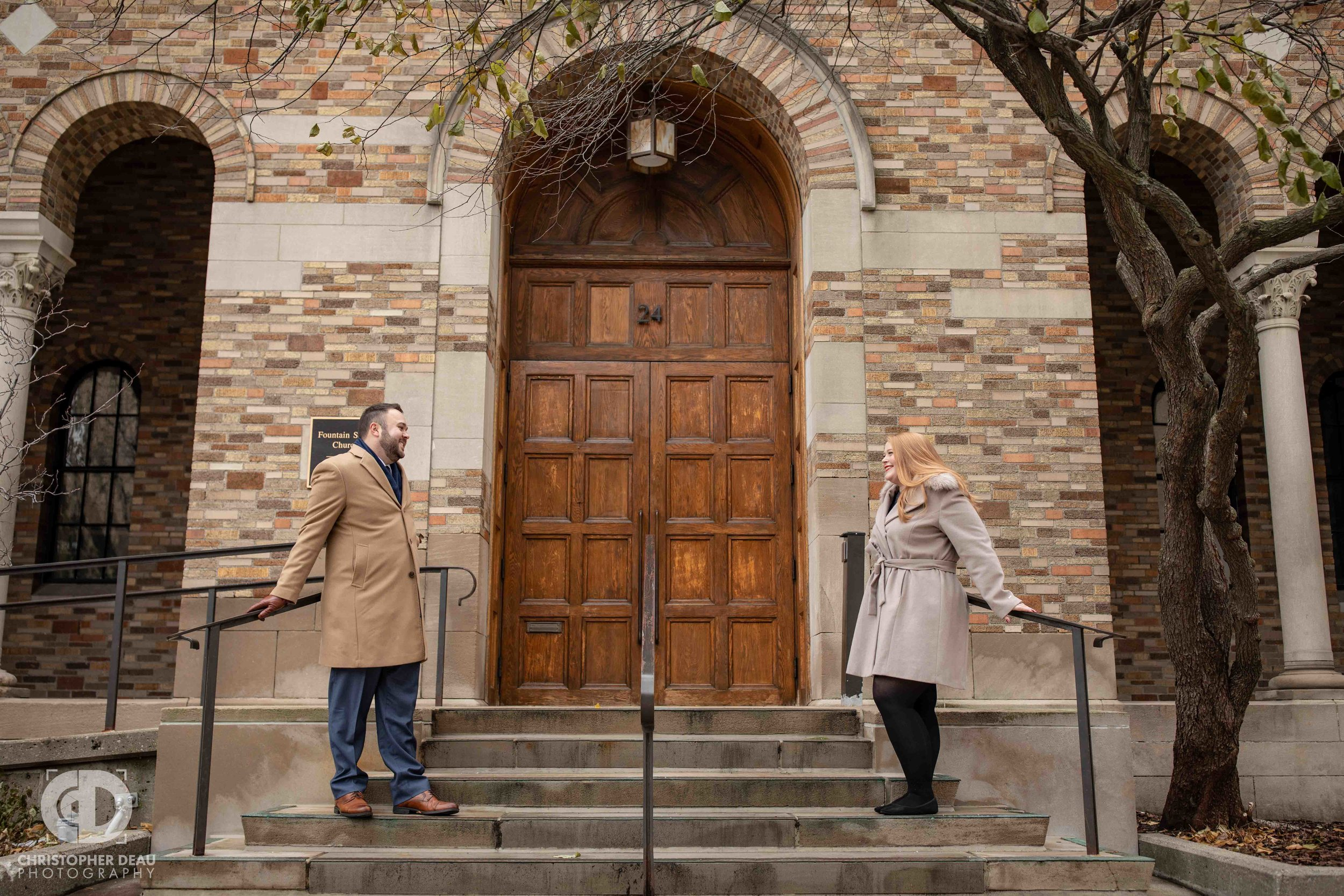 Engagement photos on the steps of the Fountain Street Church in Grand Rapids Michigan