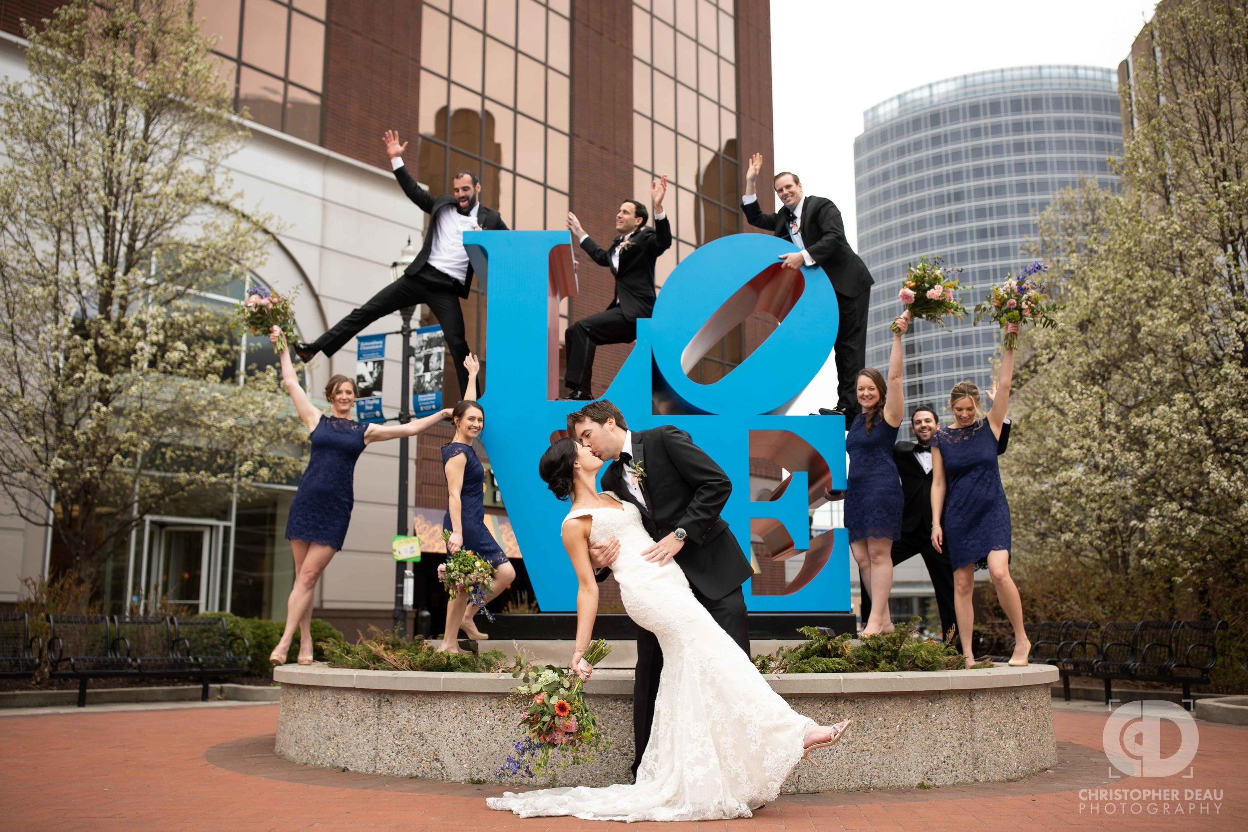 The wedding party at the love sculpture in Grand Rapids, Michigan