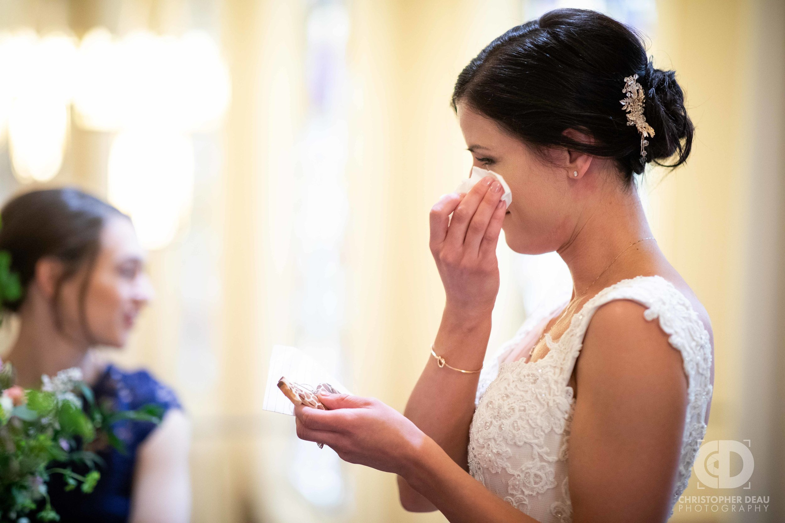 The bride crying while reading a letter from the groom