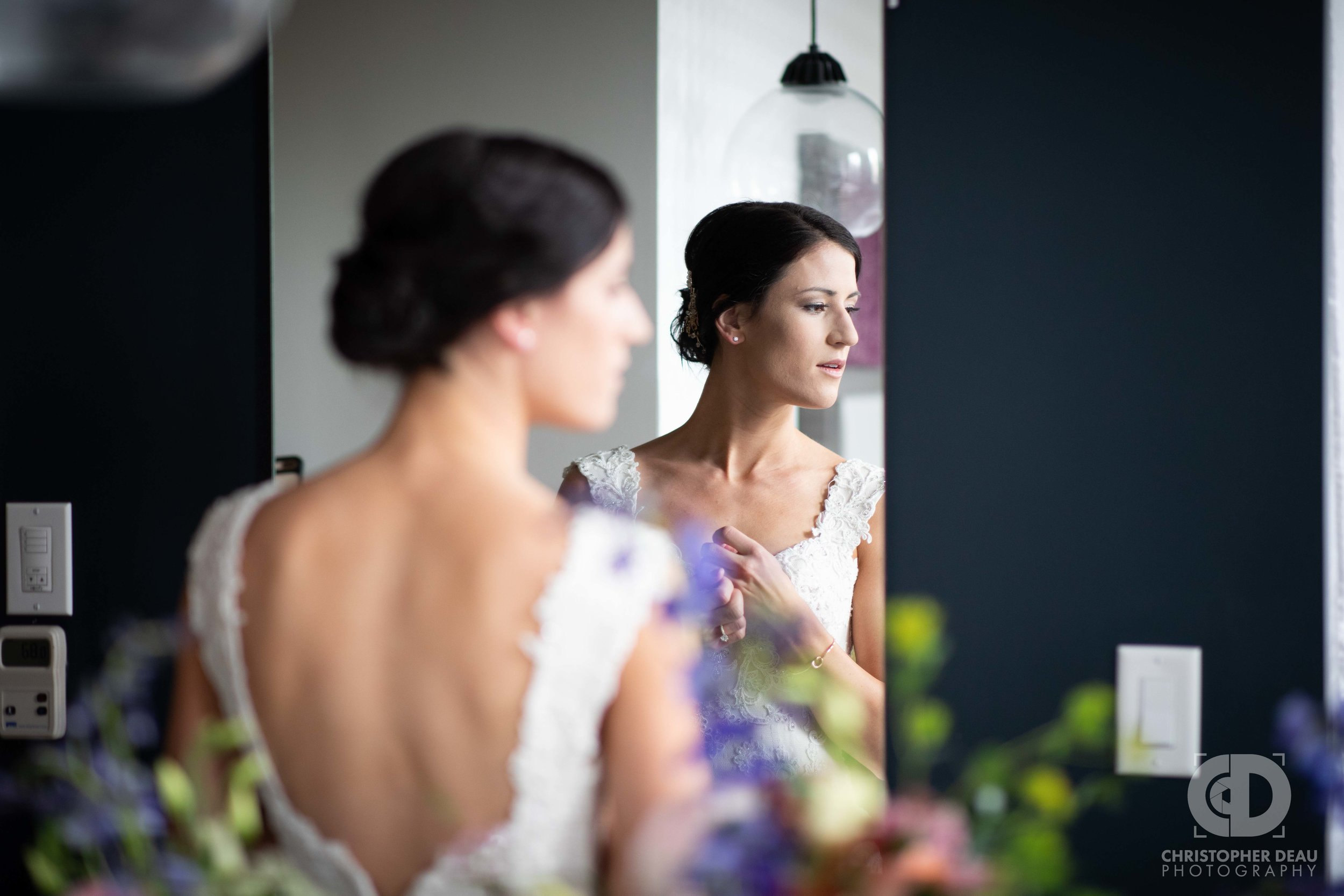 Bride in the mirror at the City Flats Hotel