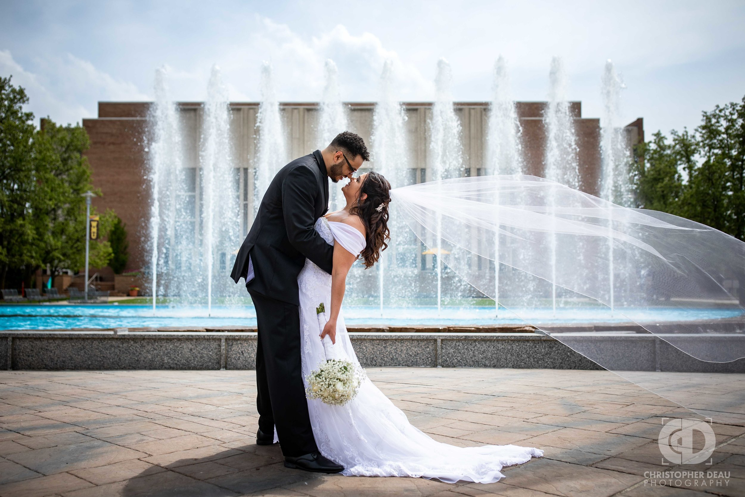 Bride and Groom portrait in front of fountain behind Miller auditorium on Western Michigan University campus