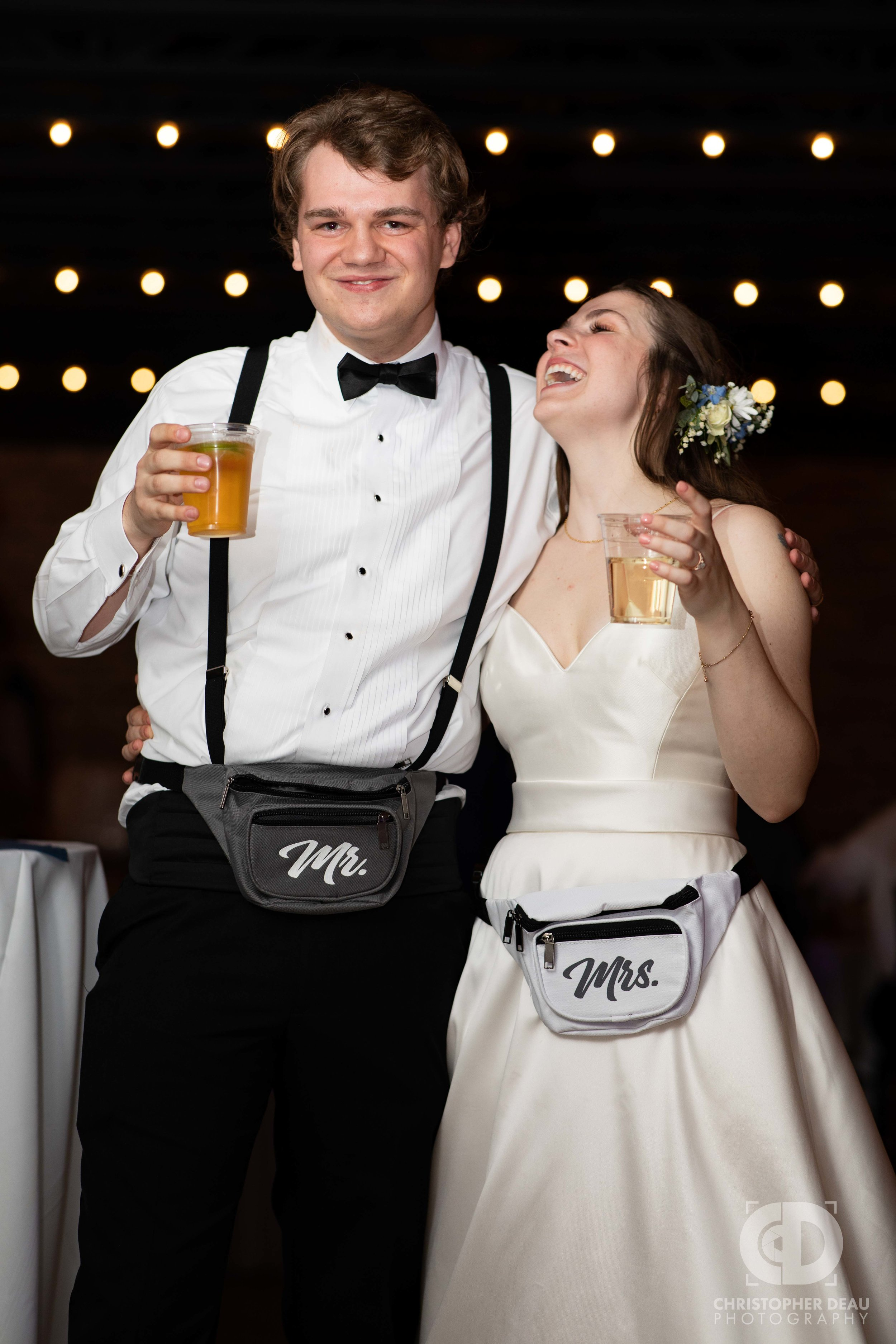 bride and groom wearing fanny packs