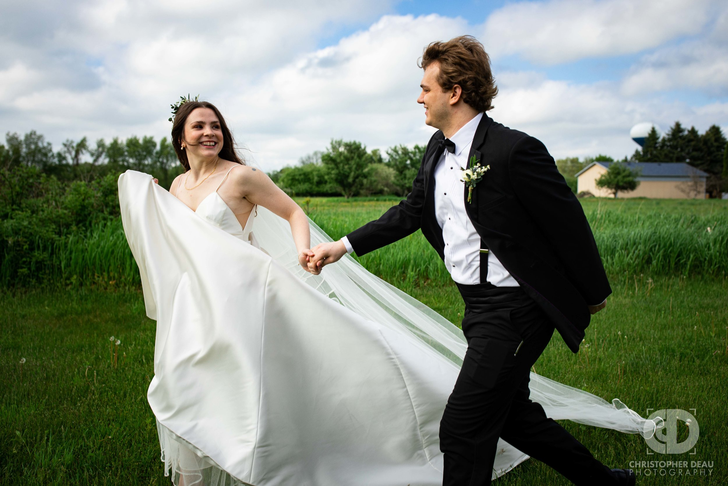 bride and groom running and laughing