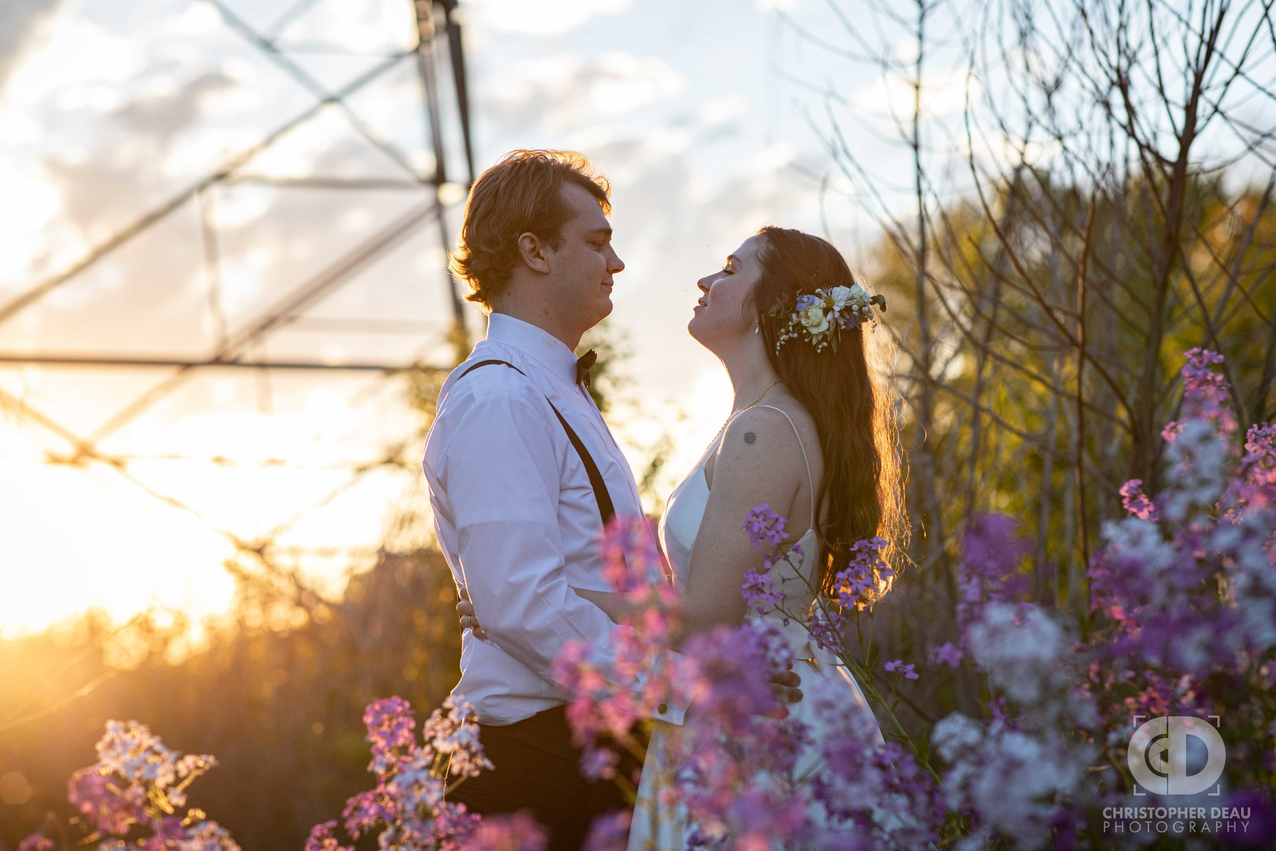 bride and groom wildflowers and sunset