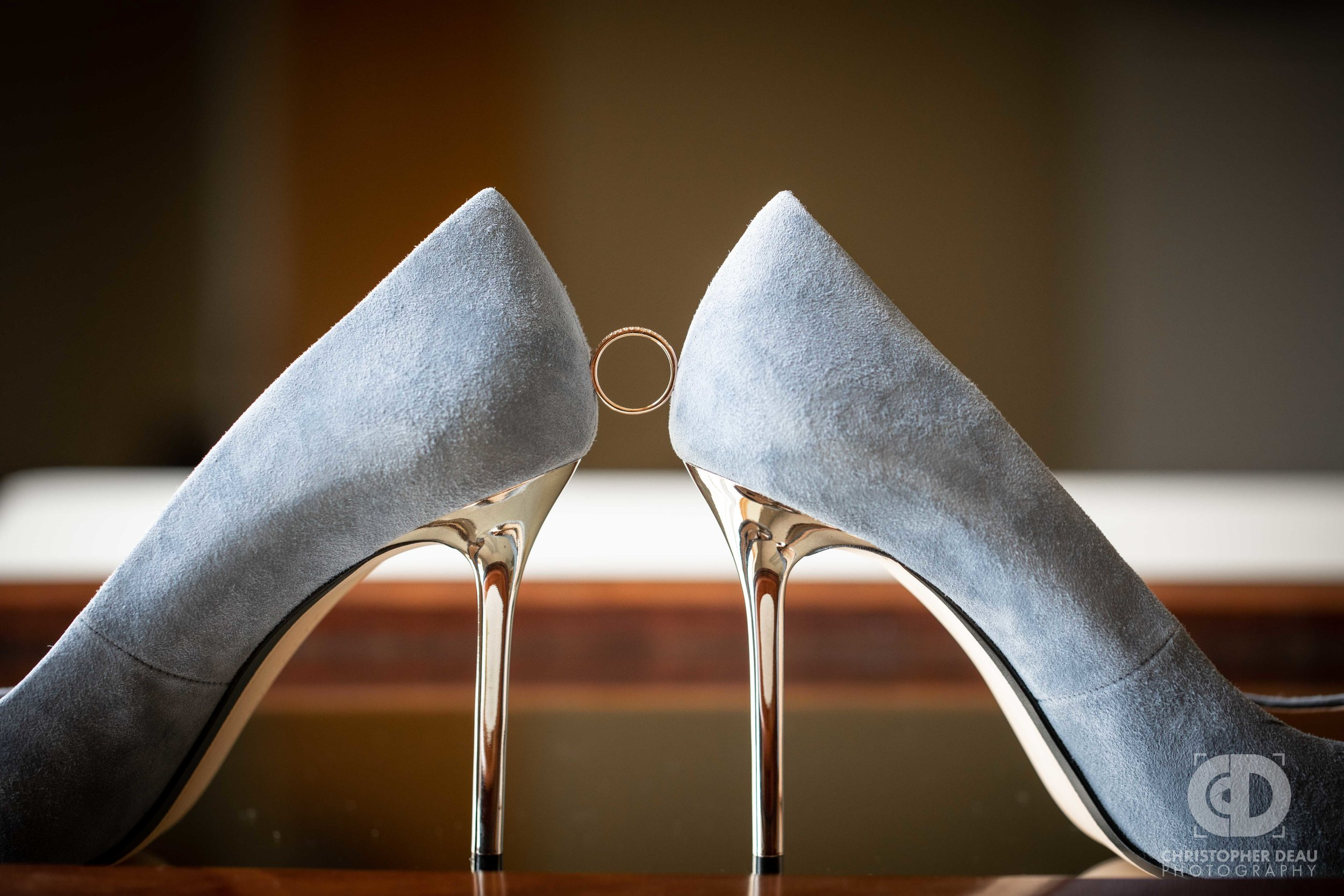 wedding ring wedged between shoes