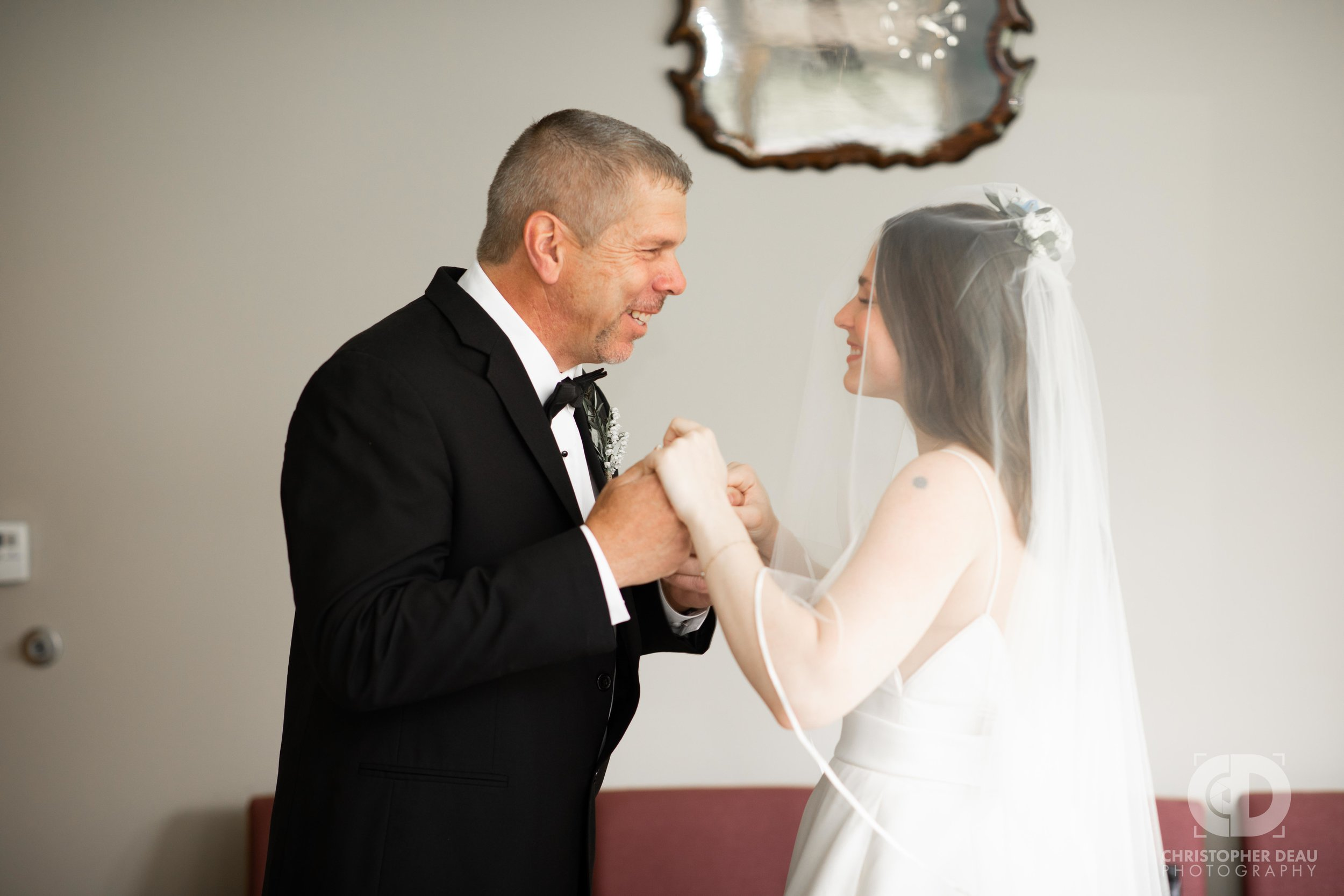 father seeing his daughter in her wedding dress first look