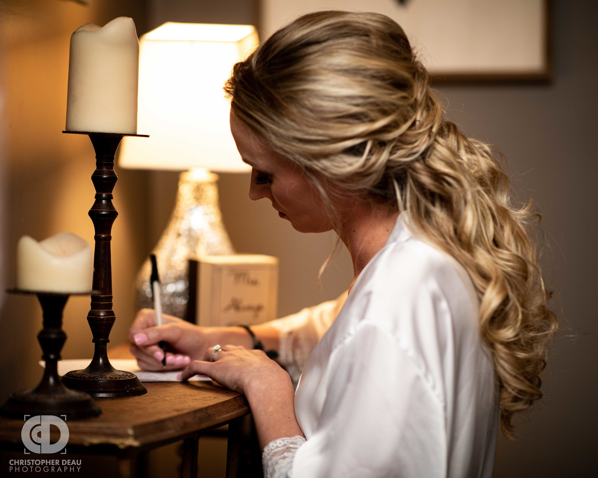 bride writing a letter to the groom